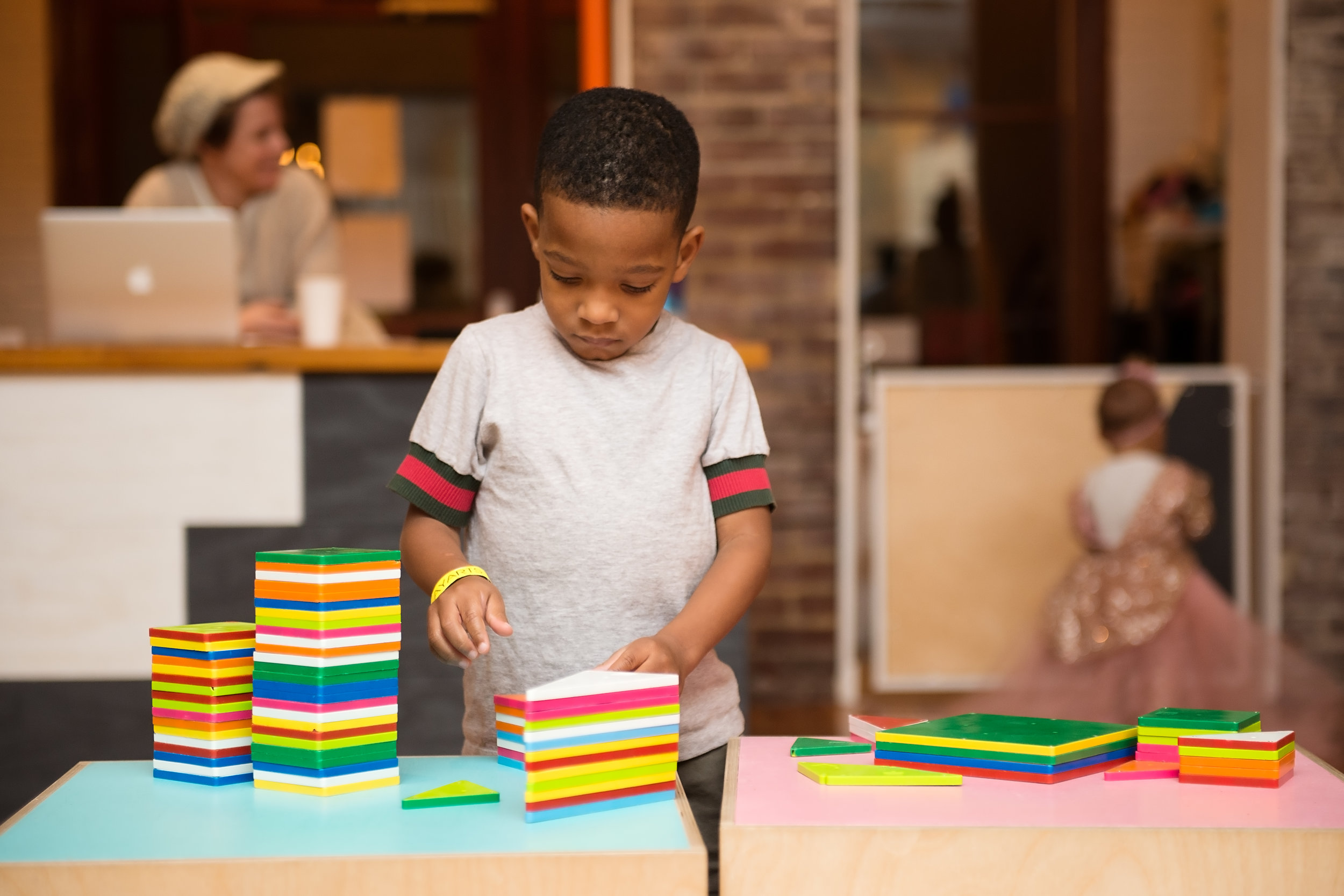 boy playing with Magnatiles