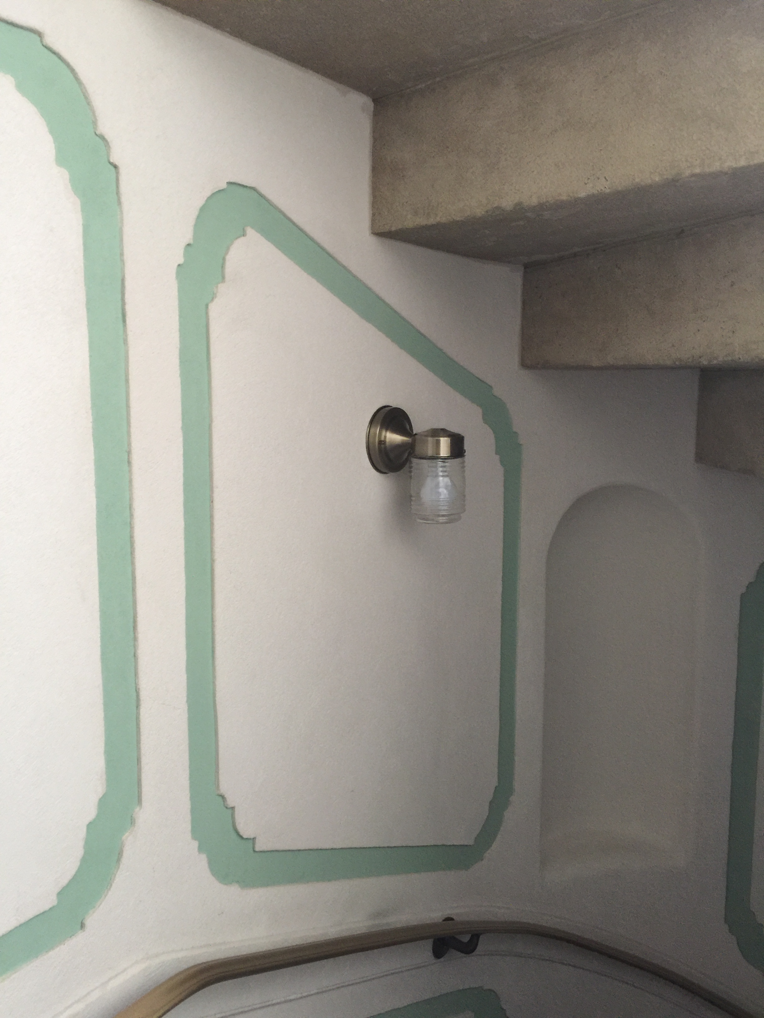 DECORATIVE TRIM - Custom plaster wall trim along the roof access stair
