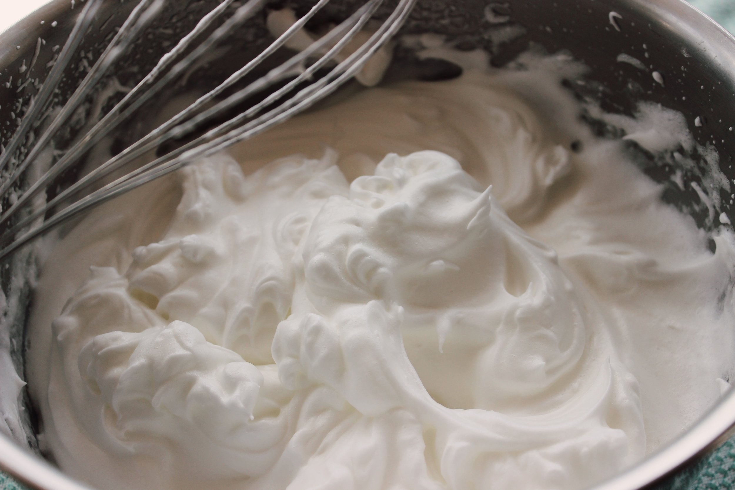 Whip the egg whites on high with the cream of tartar until quite stiff.