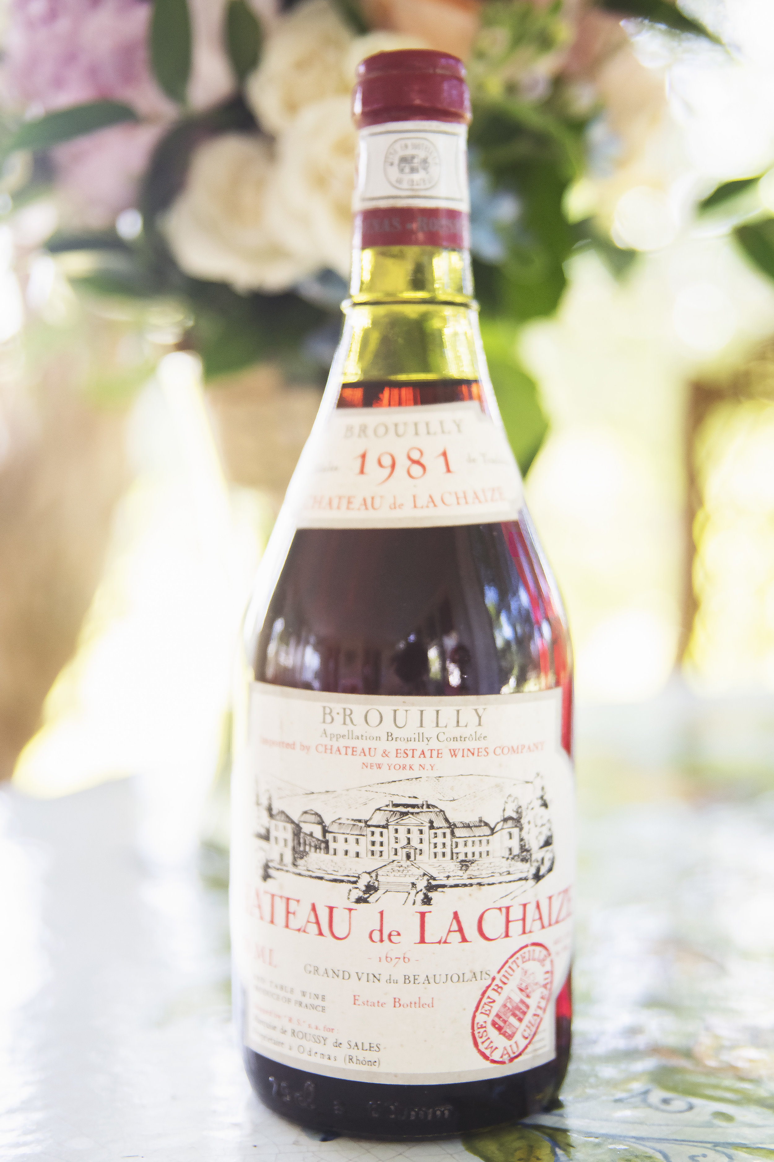 After I was born, my parents bought and stored a case of 1981 Bordeaux, the same vintage as my birth year. While their intention was that they would serve it at my wedding, I'm certain that said wedding took place well after they thought it would. So a little bit selfishly, and also because we didn't even know whether it was still good, we hung on to it until our solo dinner that night. We hopped in the car in the early evening light and drove five minutes to a local inn. We ate bacon cheeseburgers on a covered porch overlooking a river, listened to the rain pour down, and drank the best wine we've ever drunk.