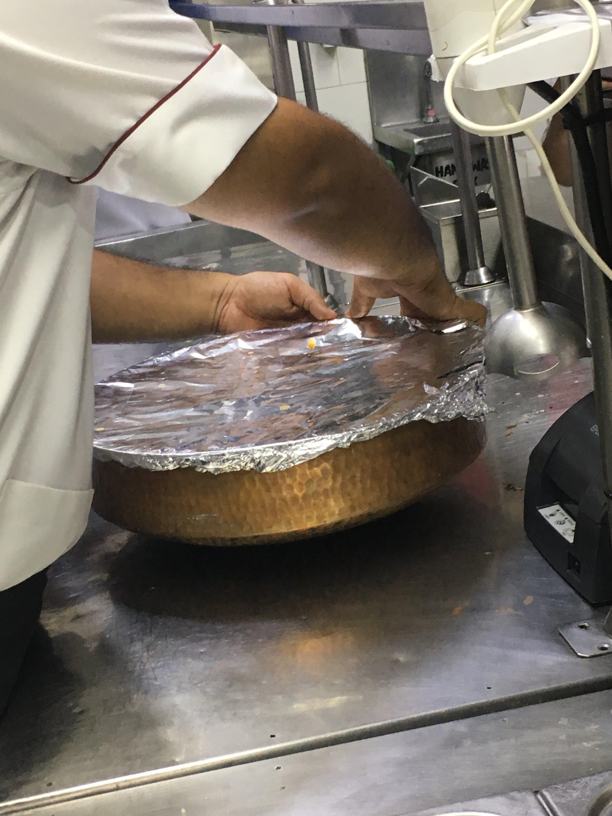 Sealing the biryani for Dum cooking