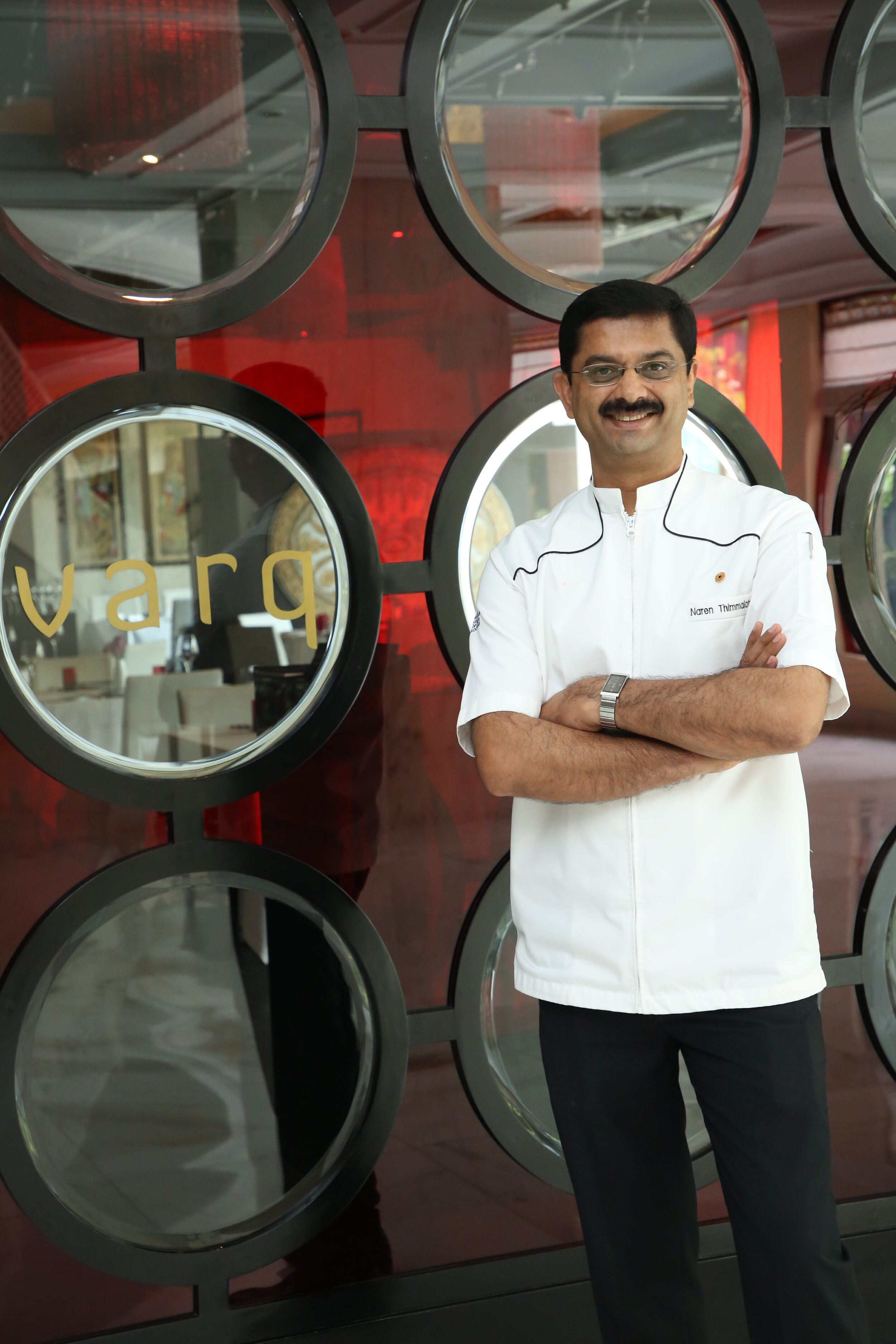 Chef Naren Thimmaiah standing outside Varq