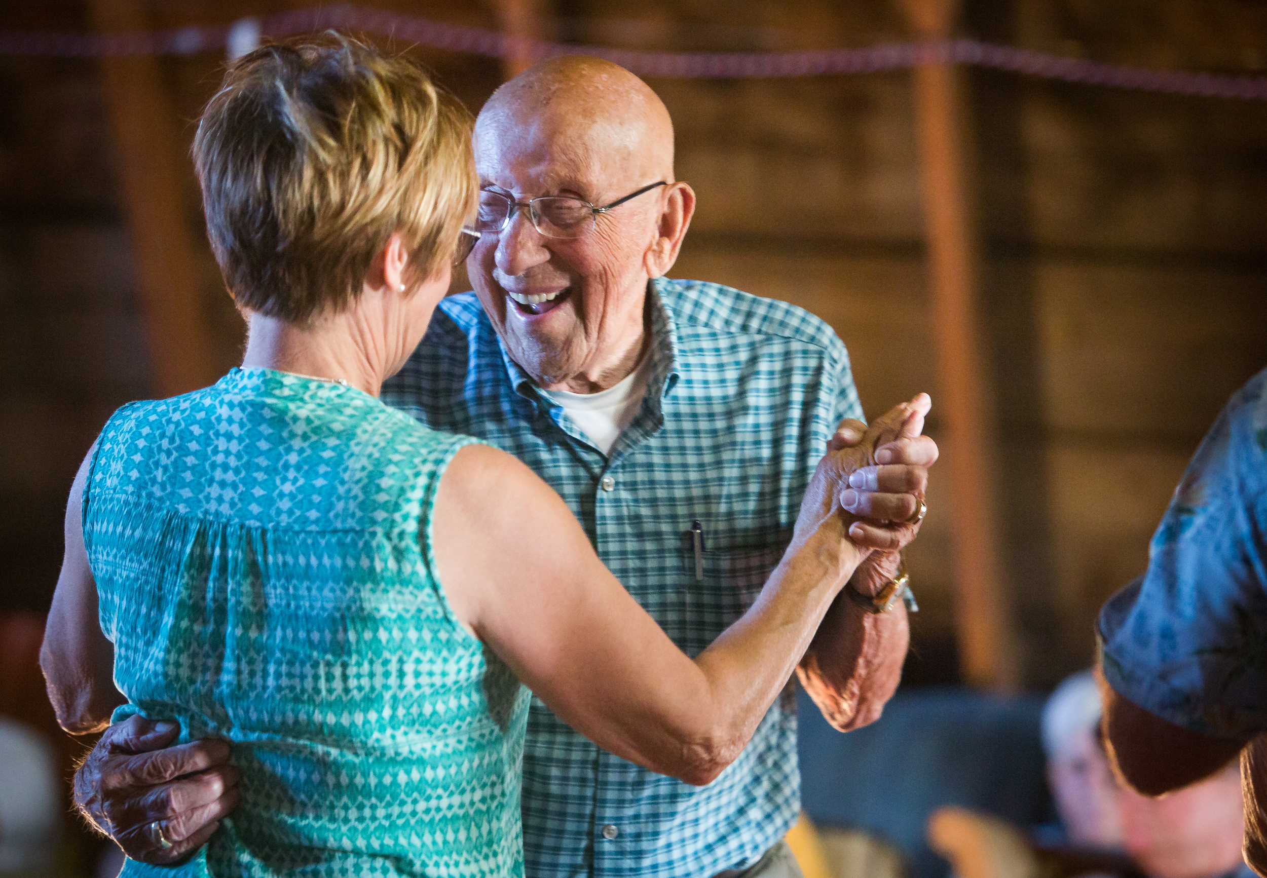 Don Johnson, 93 years old and a World War II veteran, dances with his daughter Arlyce Gibbs at Elroy Lindaas' barn dance, in Mayville, N.D. on June 25, 2016.