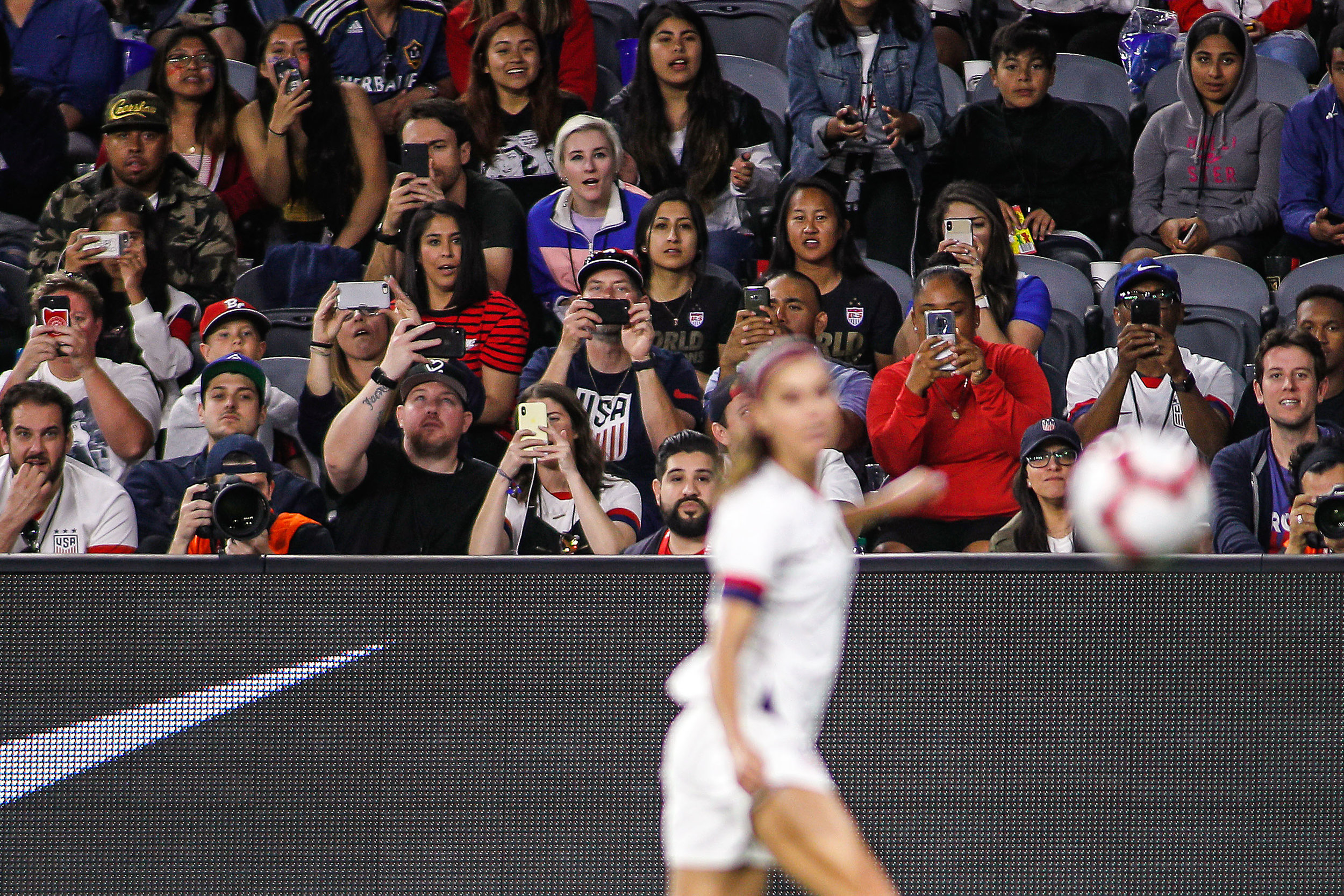 Fans photograph forward Alex Morgan of the United States Women's National Team during the friendly game against Belgium at Banc of California Stadium on April 7, 2019 in Los Angeles, California.