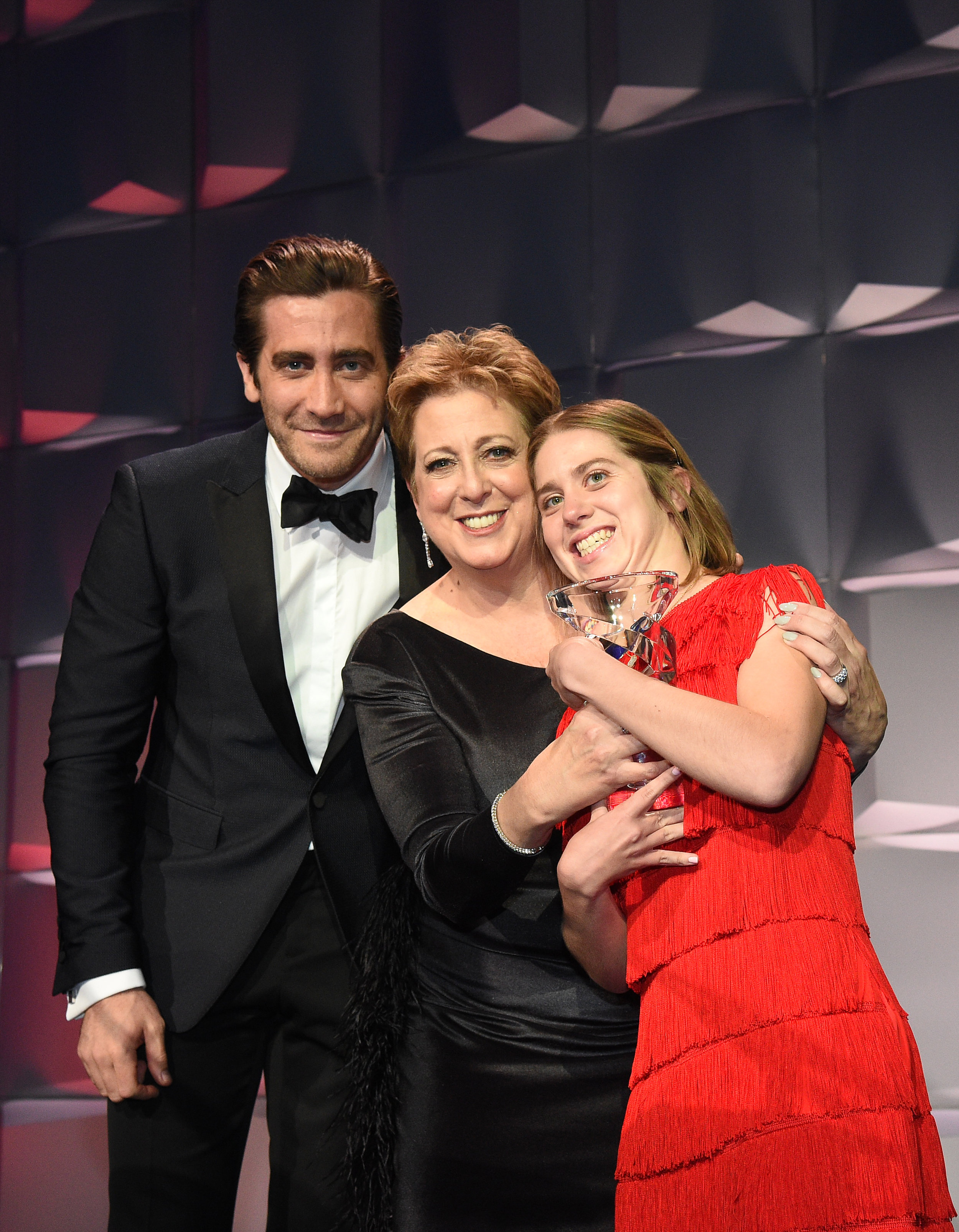 (L-R) Jake Gyllenhaal, CEO & President UNICEF USA Caryl M. Stern, and honoree Lucy Meyer attend 13th Annual UNICEF Snowflake Ball 2017 at Cipriani Wall Street on November 28, 2017 in New York City. (Photo by Bryan Bedder/Getty Images for UNICEF)