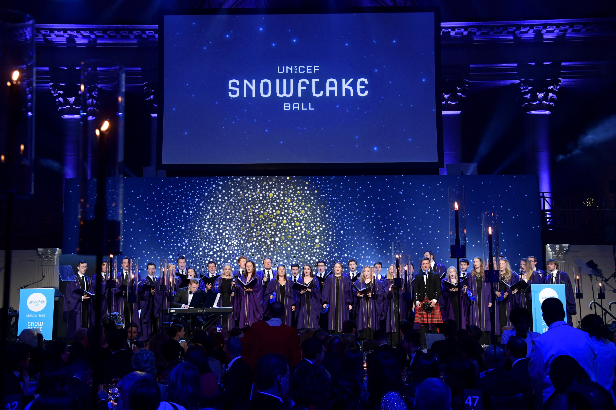 NEW YORK, NY - NOVEMBER 27: University of Aberdeen Choir performs onstage during the 14th Annual UNICEF Snowflake Ball 2018 on November 27, 2018 in New York City. (Photo by Michael Loccisano/Getty Images for UNICEF)