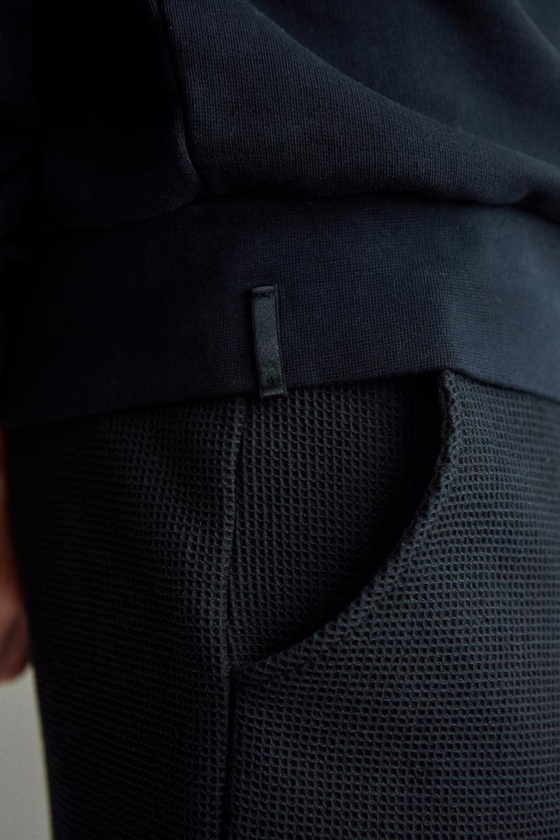 Ashley Marc Hovelle emotion face badge Sweatshirt black hem tab and waffle shorts black 0150 final.jpg