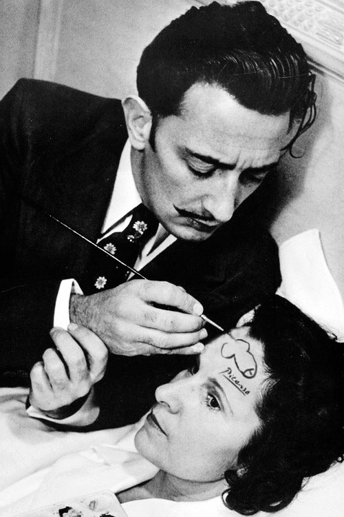 S'perfect    hotsugar :      whiteteen :   Salvador Dali drawing a penis on the forehead of a woman and signing it with Picasso's signature