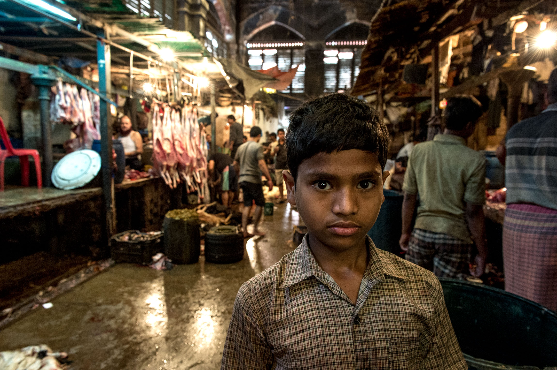 New Market Kolkata India slaughterhouse | a child worker posing in the meat hall of New Market.