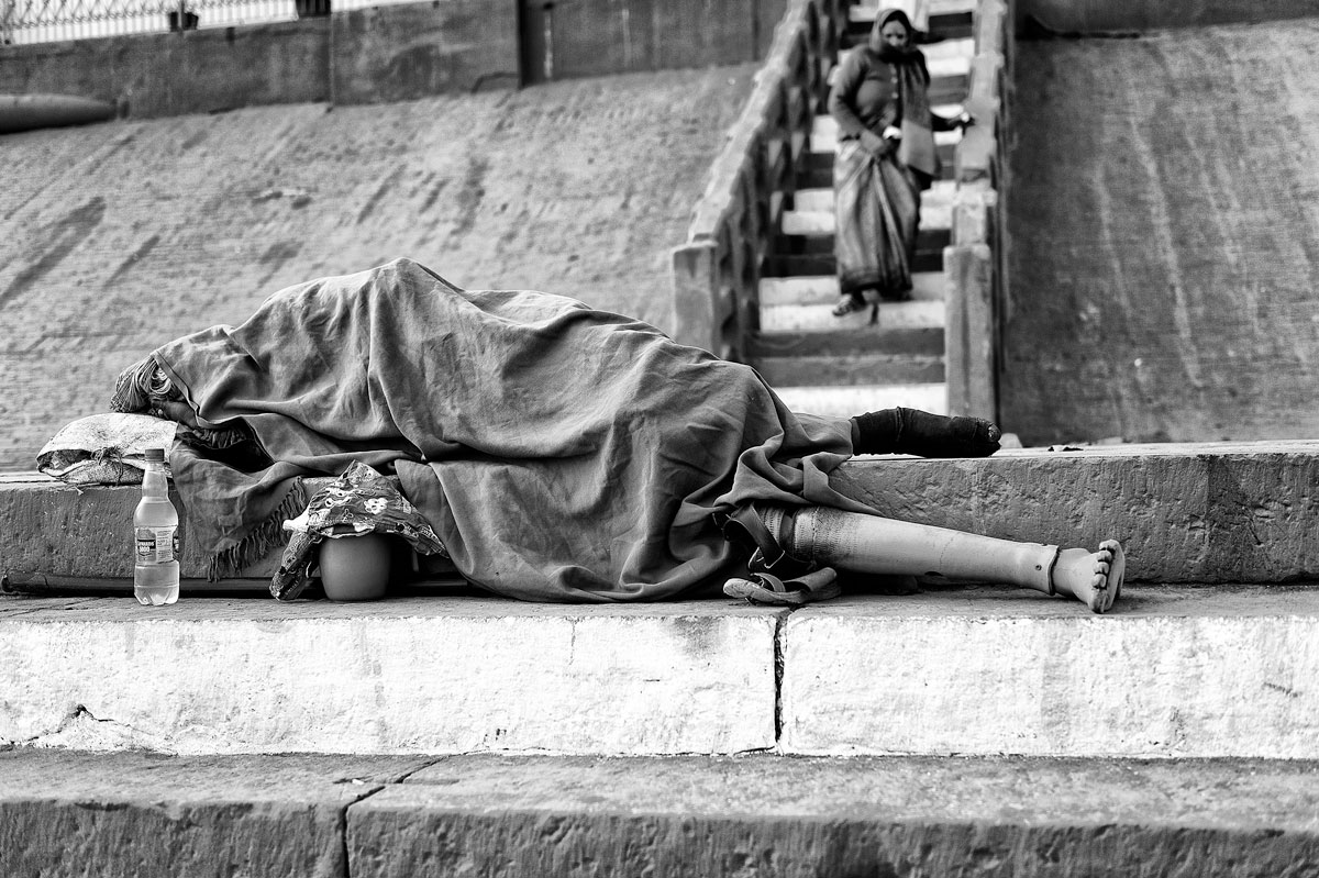 Browse my archive of January 2013 photos from Varanasi. A homeless man sleeps on the banks of the Ganges.