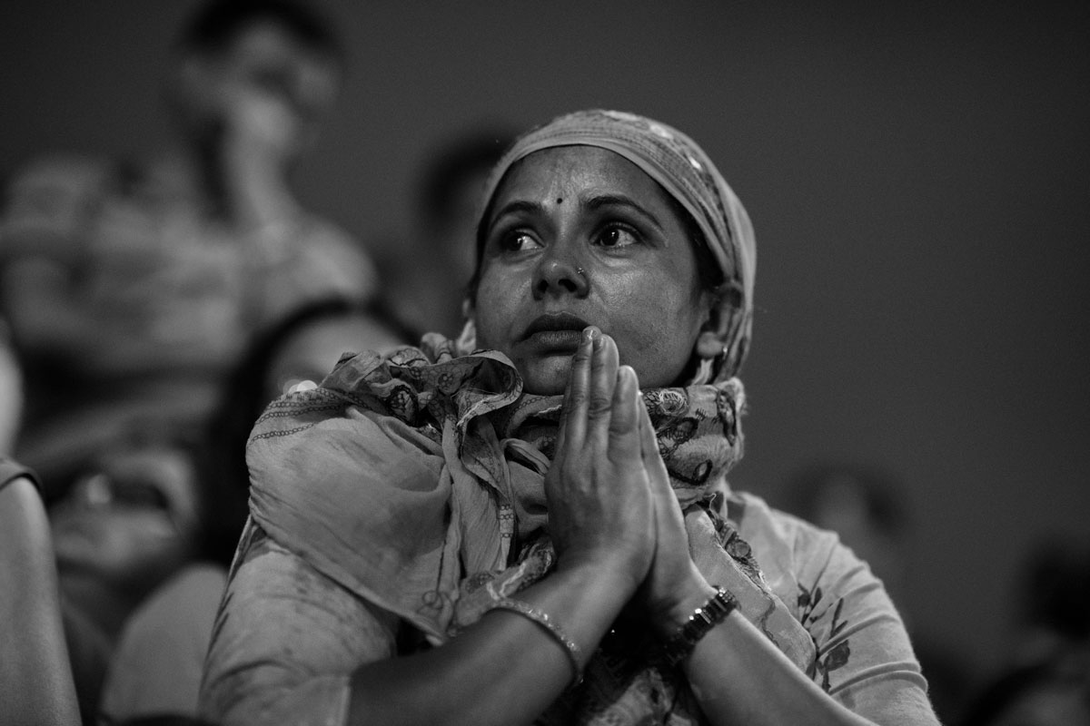 A devotee observing the Aarti. Aarti is a Hindu religious ritual of worship.