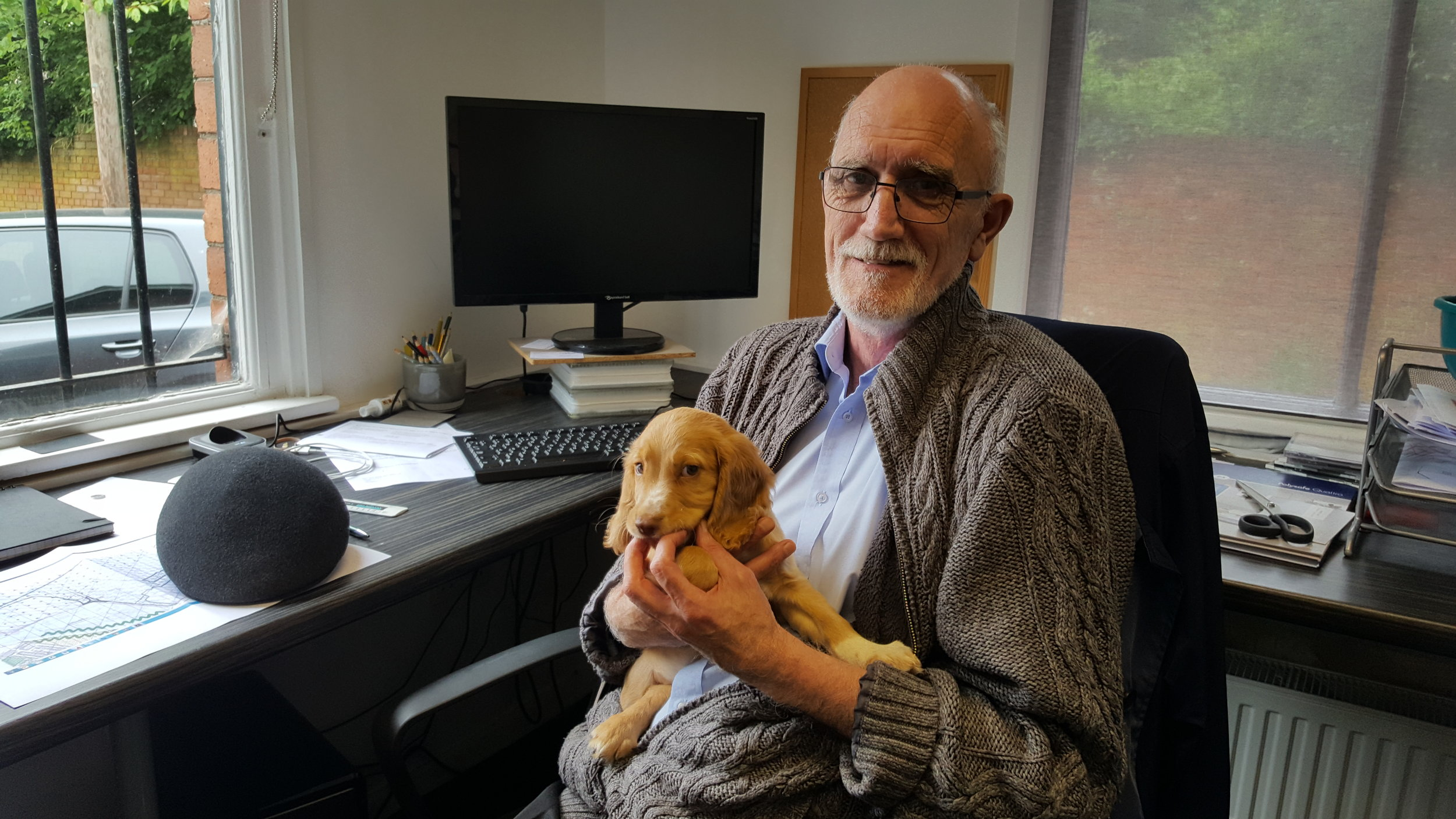 Dave Stidwell, Senior Architectural Technician, C.A.Ross Design - with office dog, Monty!