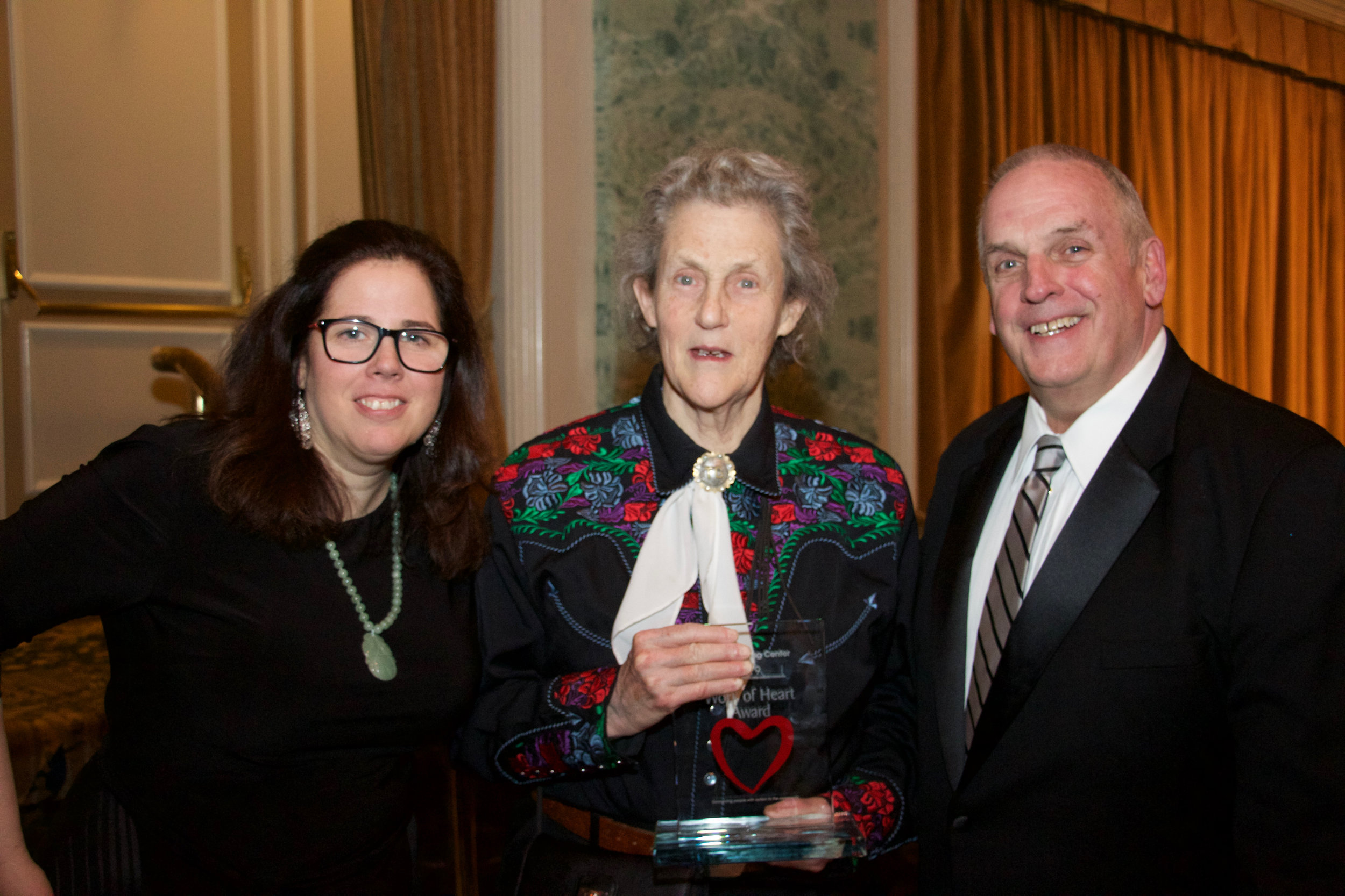 (from left) PACTT Executive Director, Dr. Kristen Huffman-Gottschling; Work of Heart honoree Dr. Temple Grandin; PACTT Development Director, Terry Herbstritt