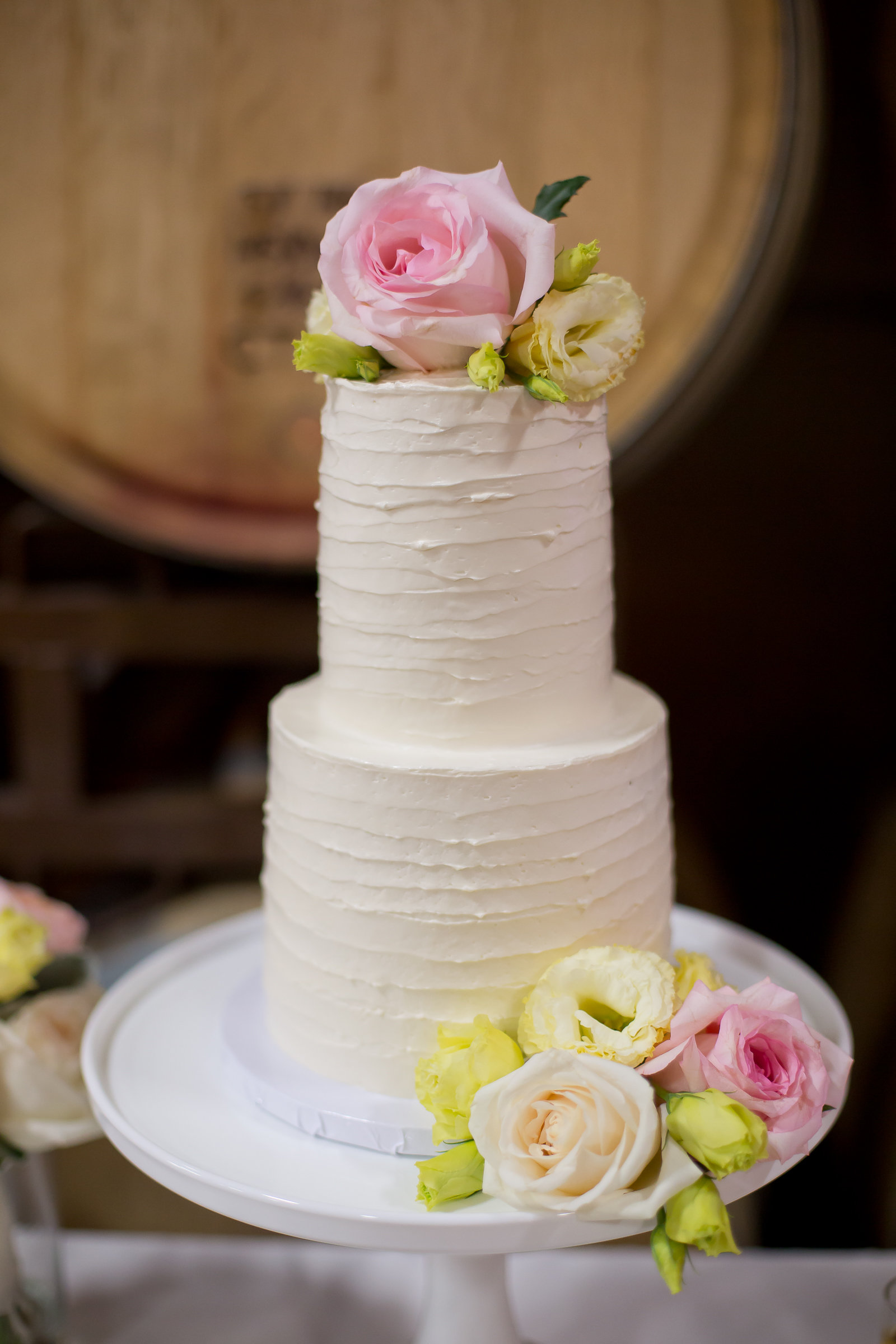 White Frosted Cake and Pastel Flowers | Michelle Garibay Events