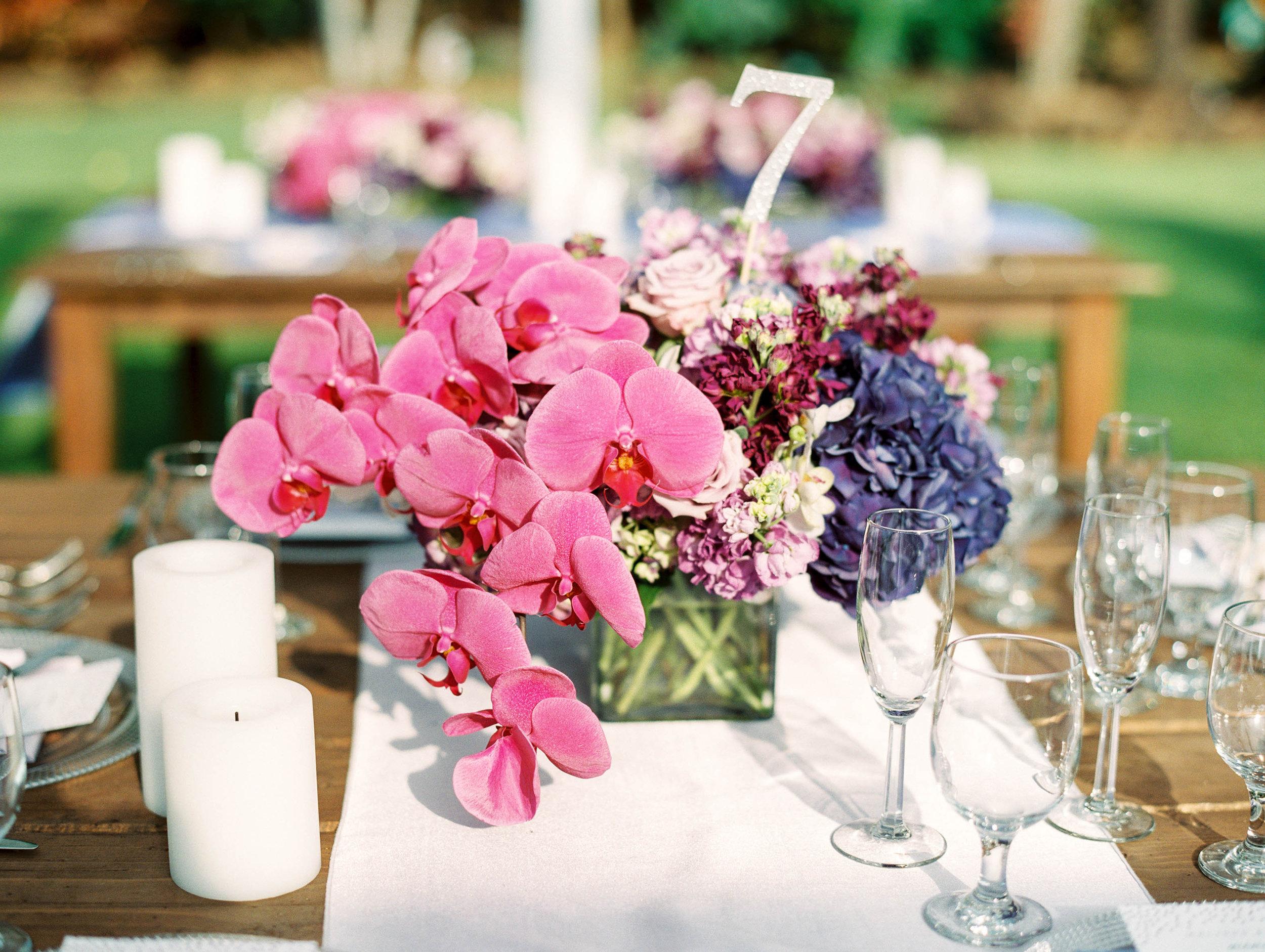 Michelle Garibay Events | Elegant Oahu Wedding | Loulu Palm Estate | Destination Wedding Planner | Purple Orchid Centerpiece