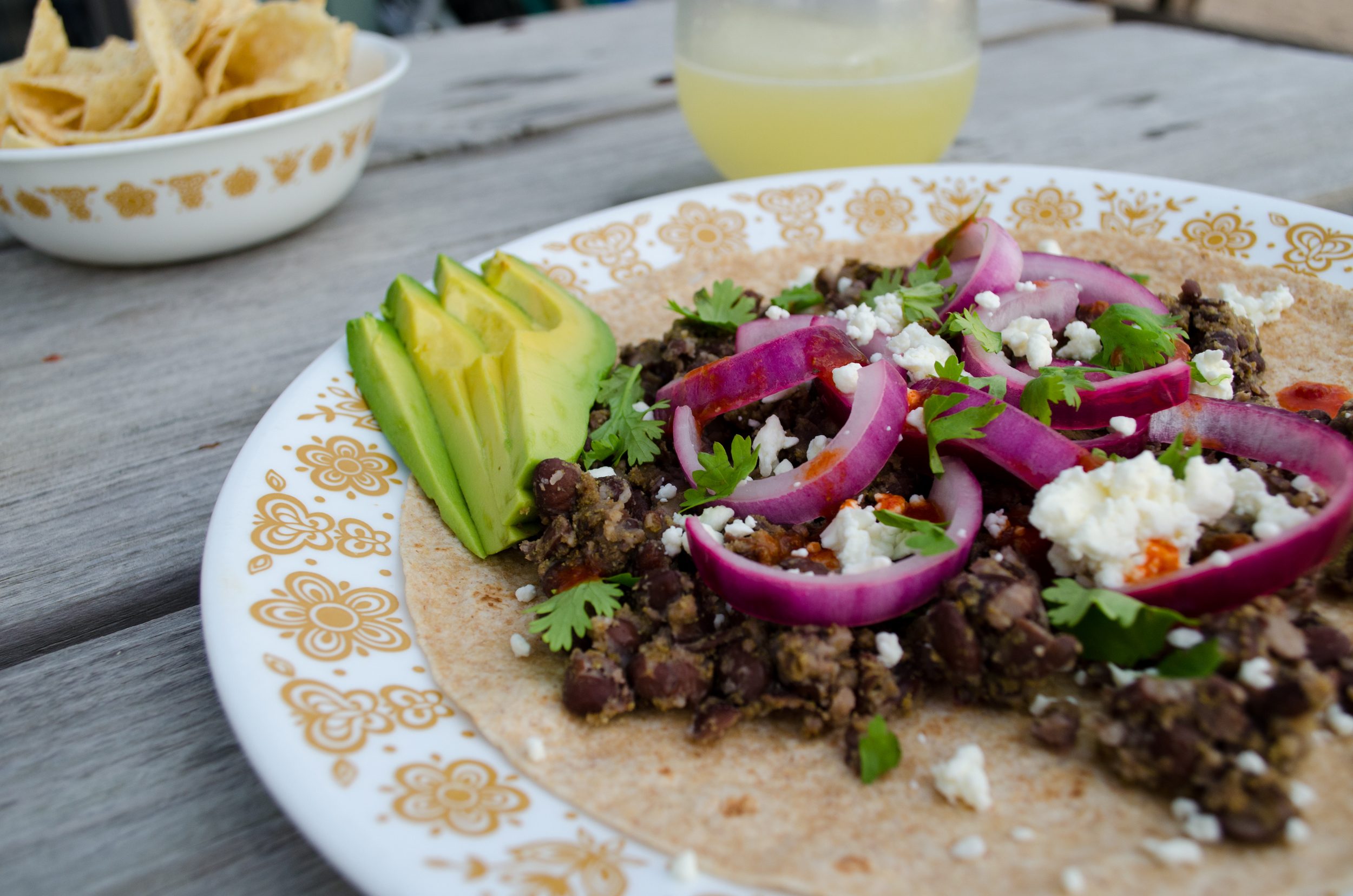 Black bean tacos with pickled red onions and feta
