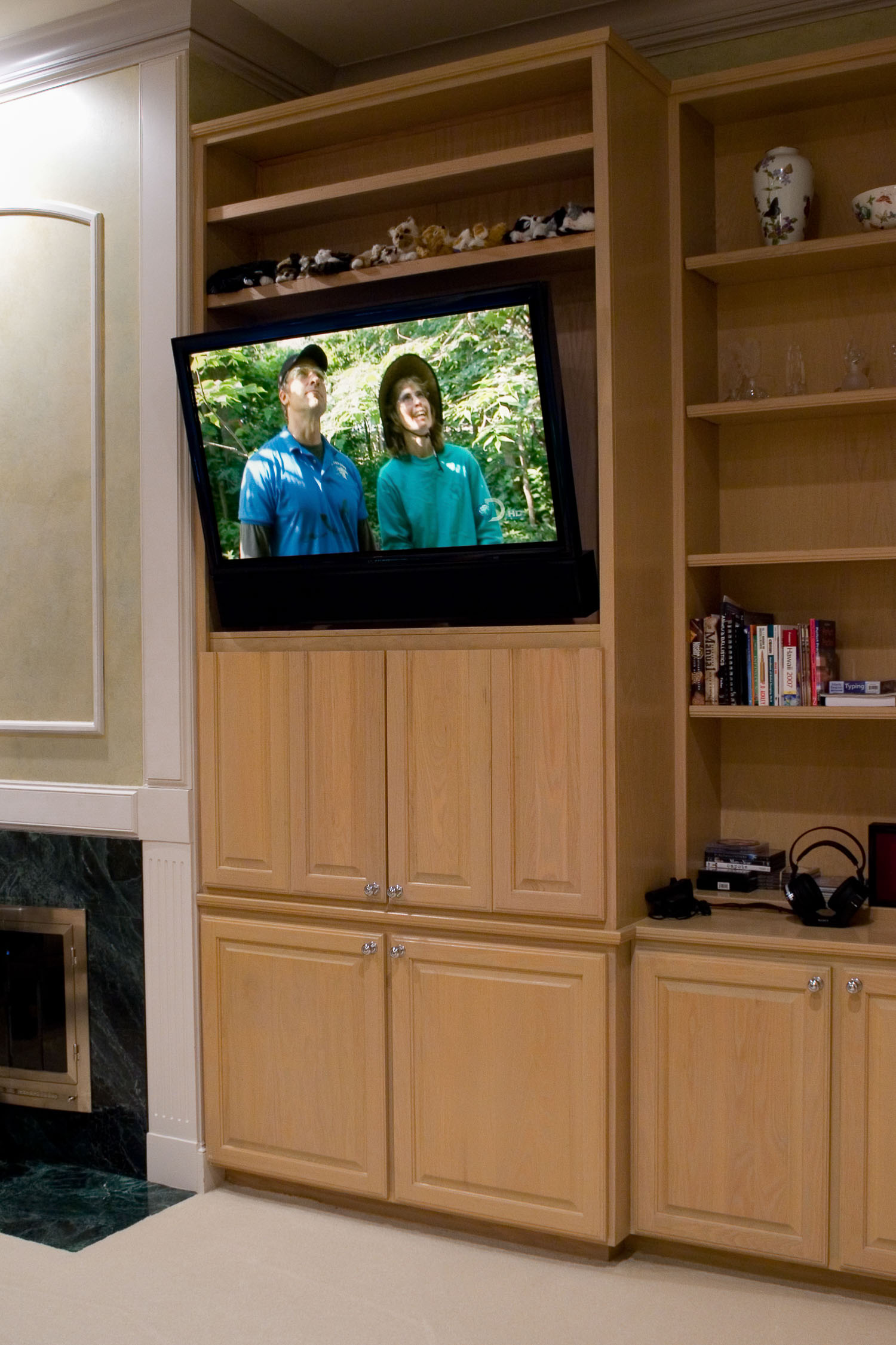 This flat-screen TV is mounted on an articulating arm that can be tilted and moved with a remote control.