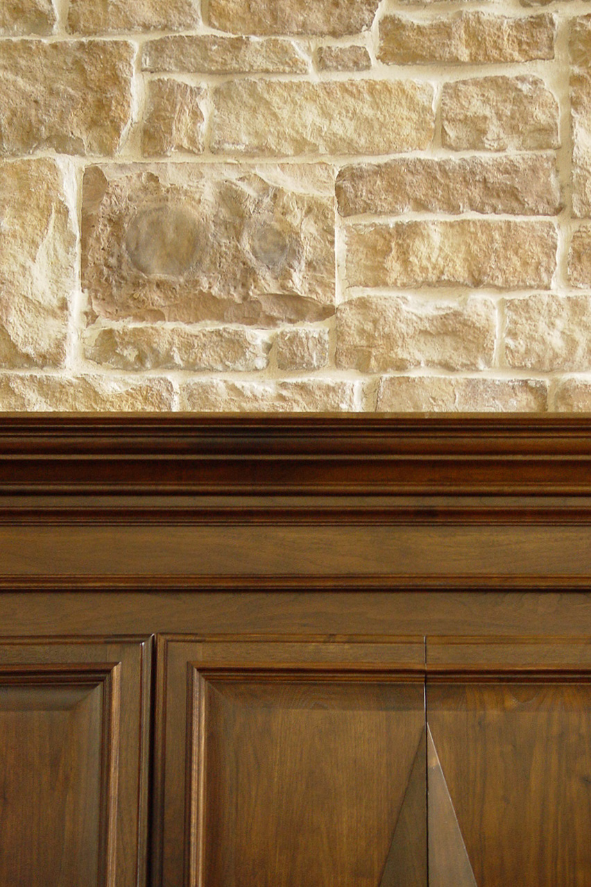Hidden Speaker in Hickory Creek, Texas  Our clients wanted music and entertainment in the den of their very formal Hickory Creek home; however, they didn't want to see any speakers. So, we sent a rock sample to  Rockustics, Inc. , who made two hidden speakers to be mortared into the rock facade around the fireplace and above the cabinets. They sound great, and no one knows they're there.