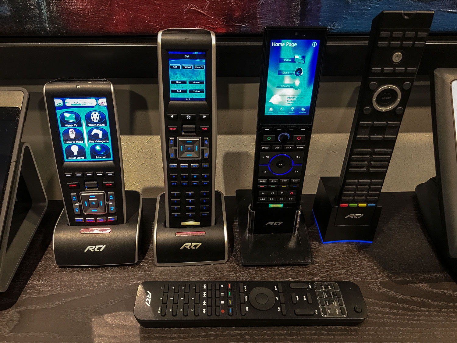 Here are a few of the small-but-mighty handheld remotes that are so popular with our clients.  Please come by for a demo!