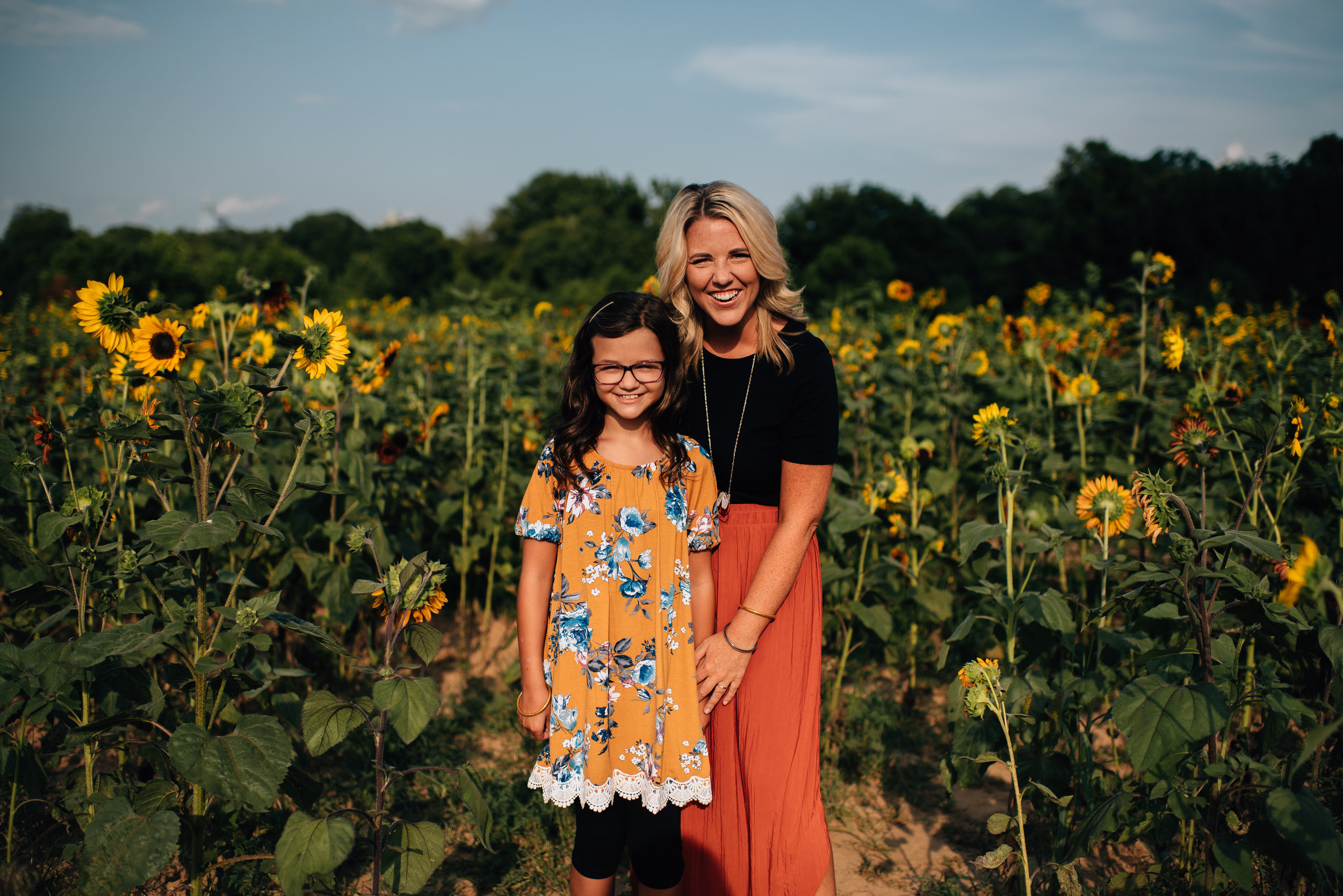 dorthea dix family session - raleigh family photographer - north carolina family photographer - sunflower family session - mommy and me photo session - mom and daughter photos