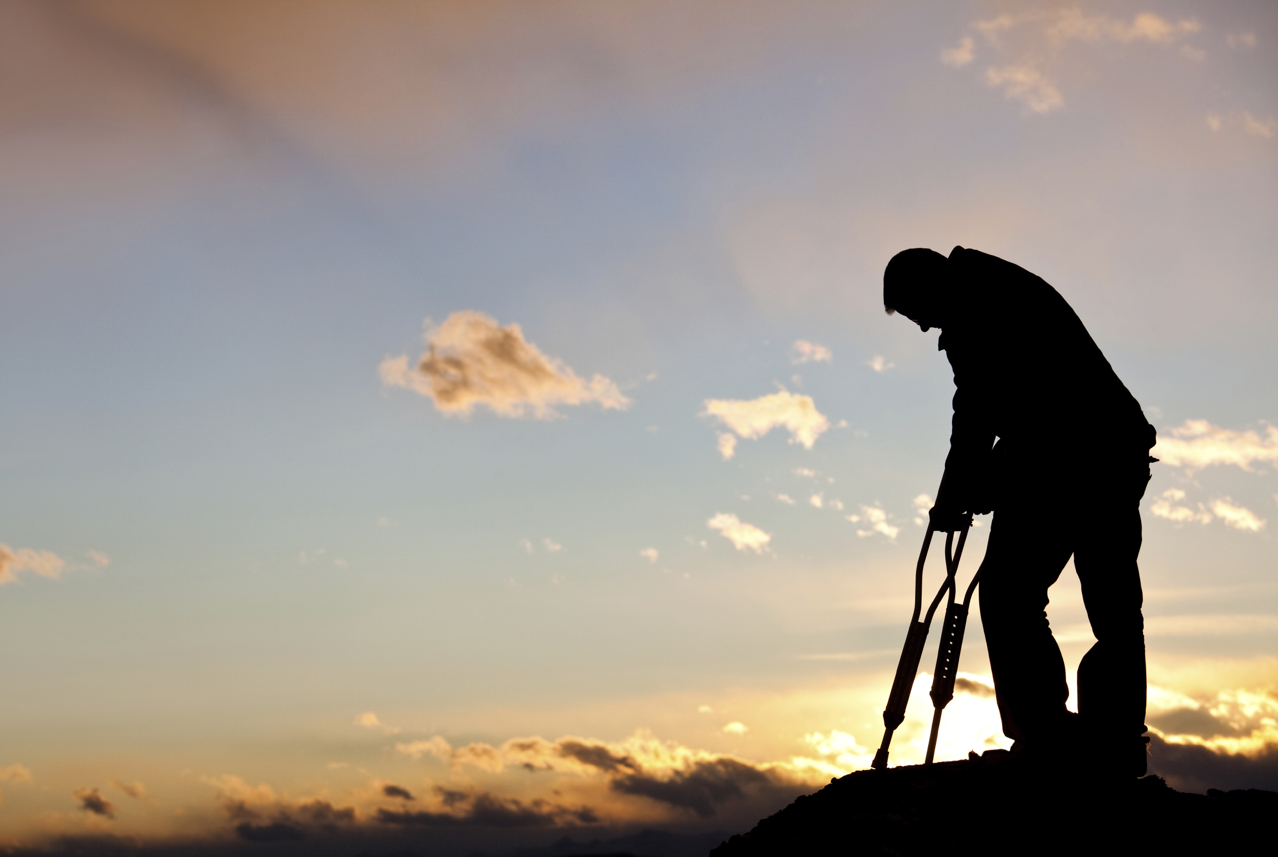 http://www.istockphoto.com/photo/silhouette-of-a-sad-injured-man-with-crutches-18496949