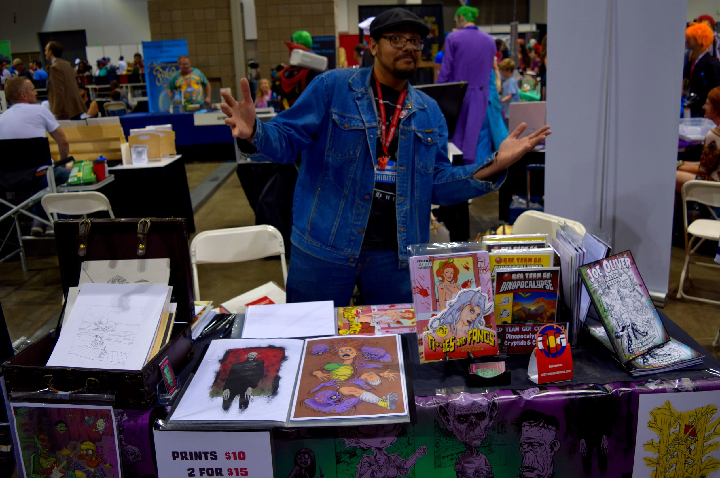 Joe Oliver behind his table at Denver Comic Con 2016.