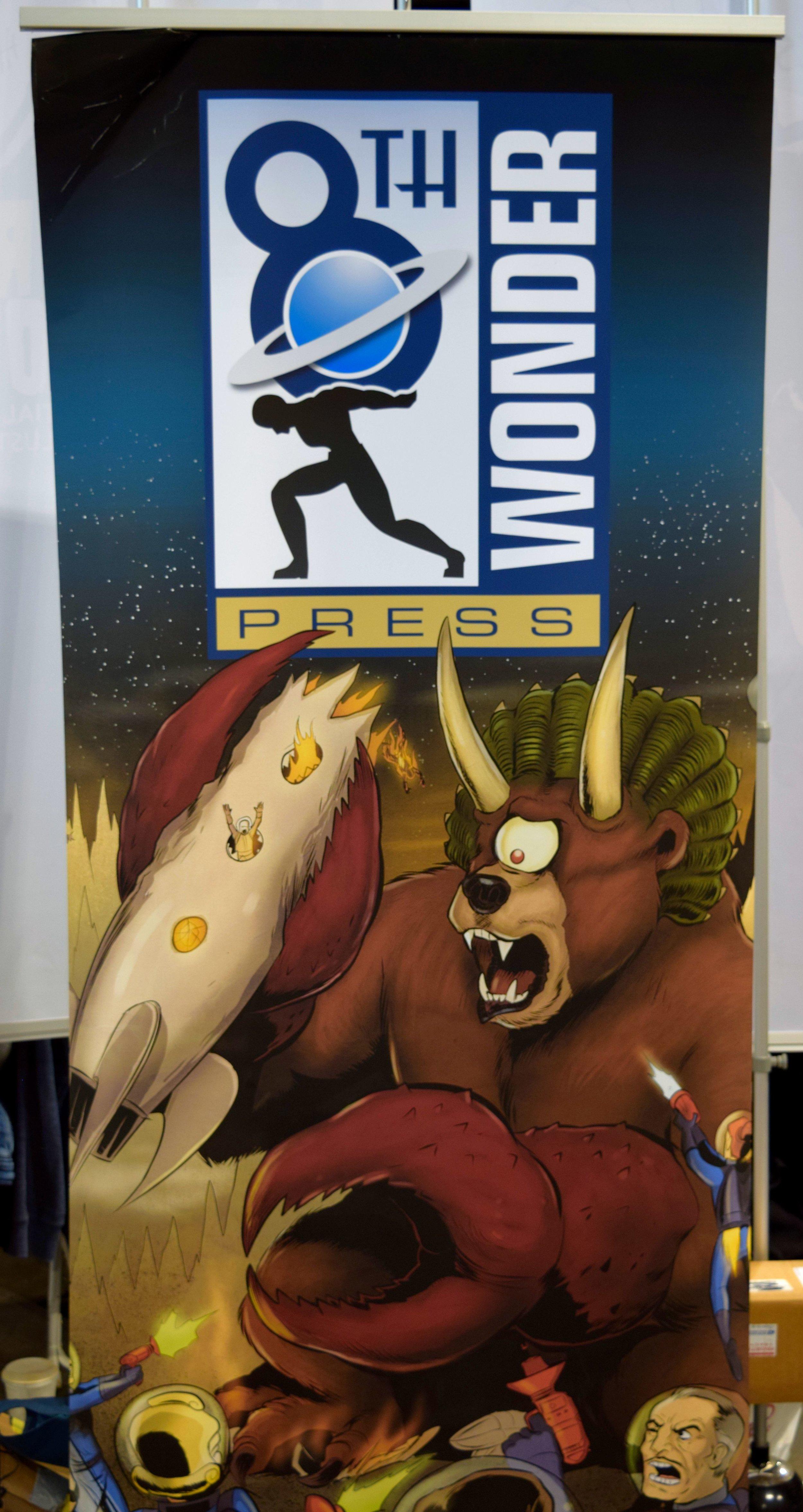 8th Wonder Press banner at Denver Comic Con 2016.
