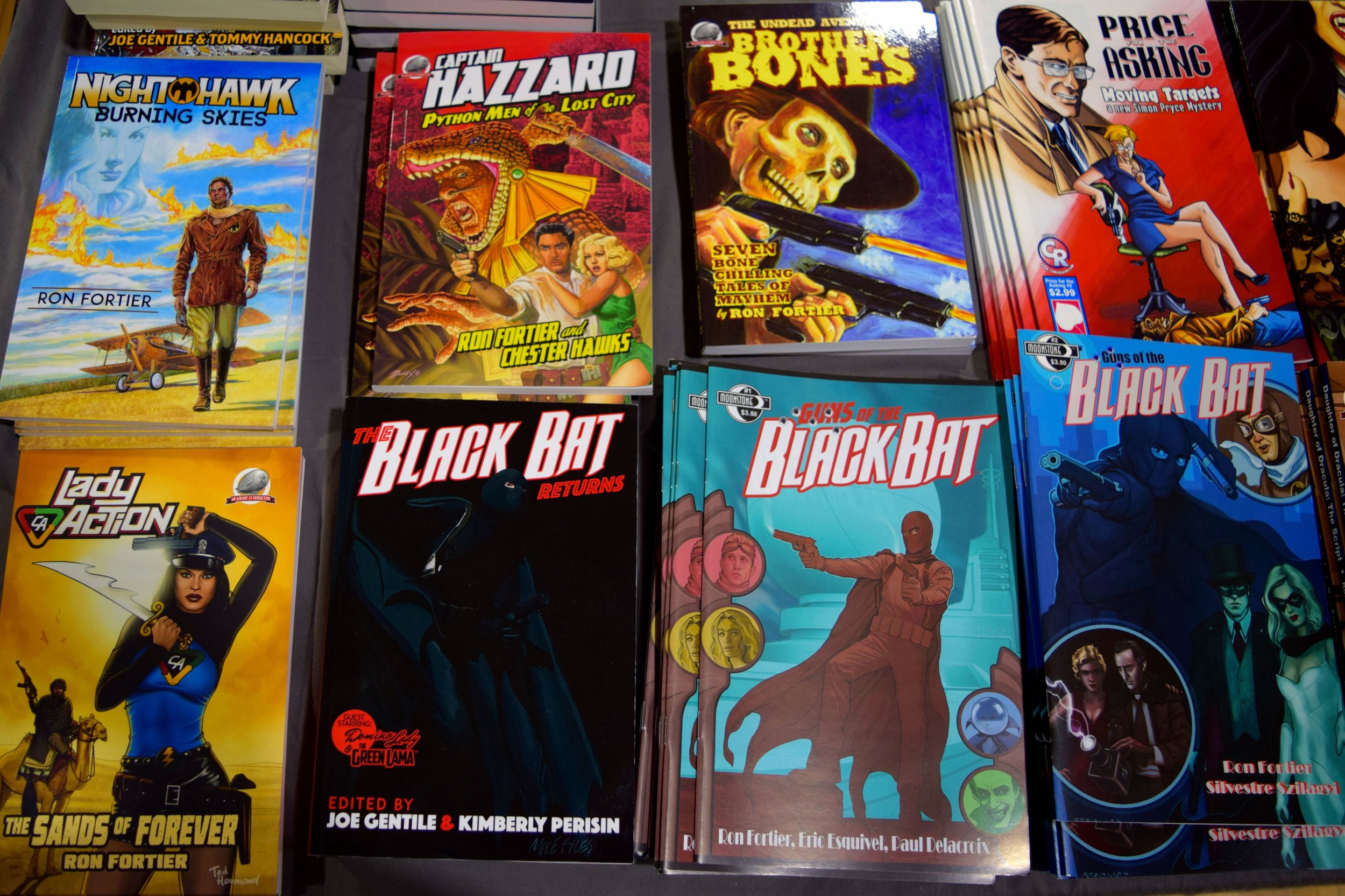 Pulps and comics from Ron Fortier at Fort Collins Comic Con 2016.
