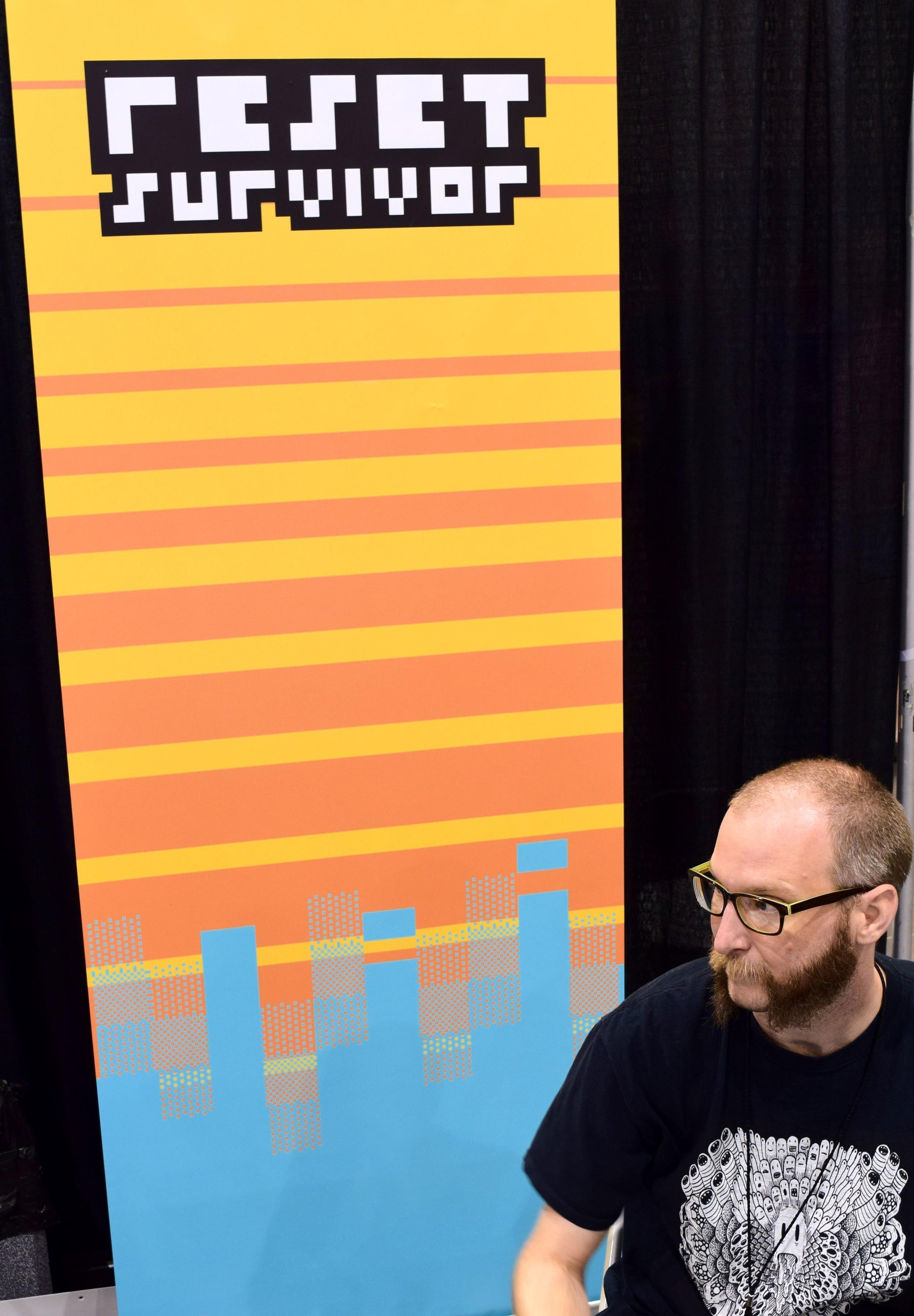 Reset Survivor and his banner at Phoenix Comic Con 2017.