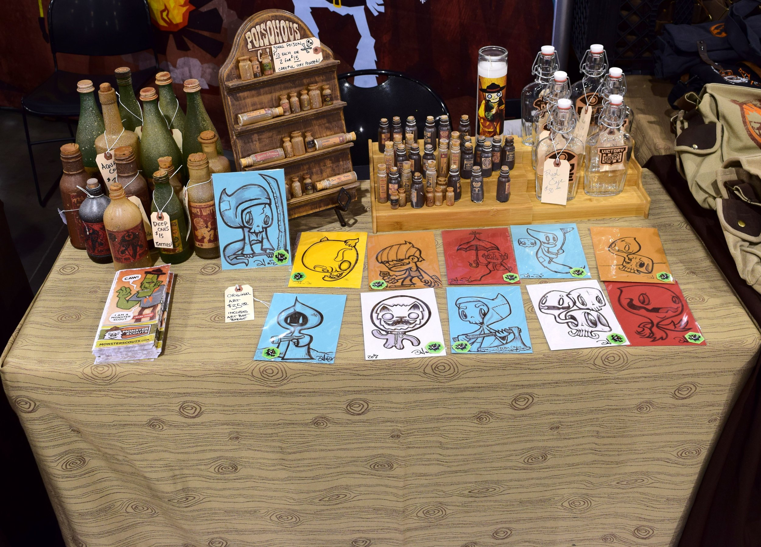 Original art and potion bottles from Steam Crow at Phoenix Comic Con 2017.