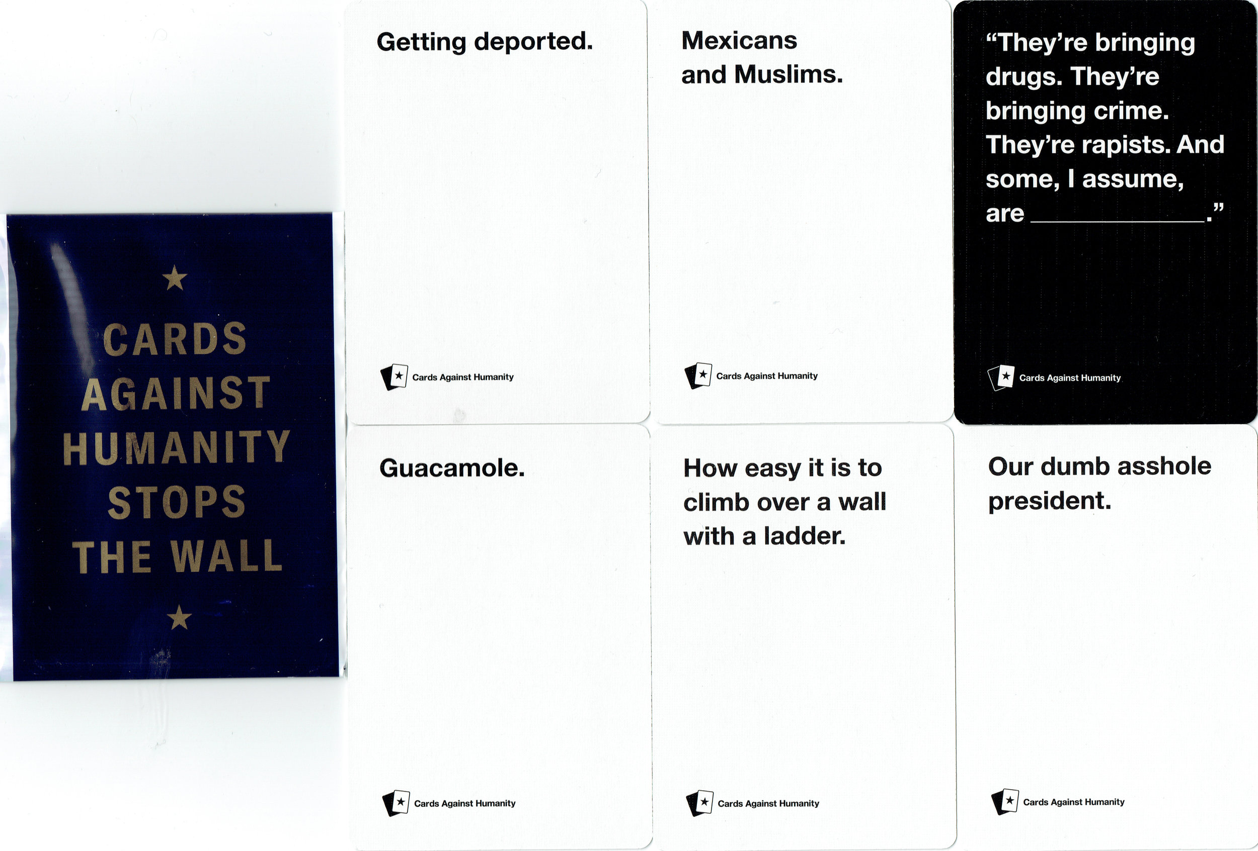 """Cards Against Humanity Saves America Day One """"CAH Stops The Wall"""" card pack. (fronts)"""