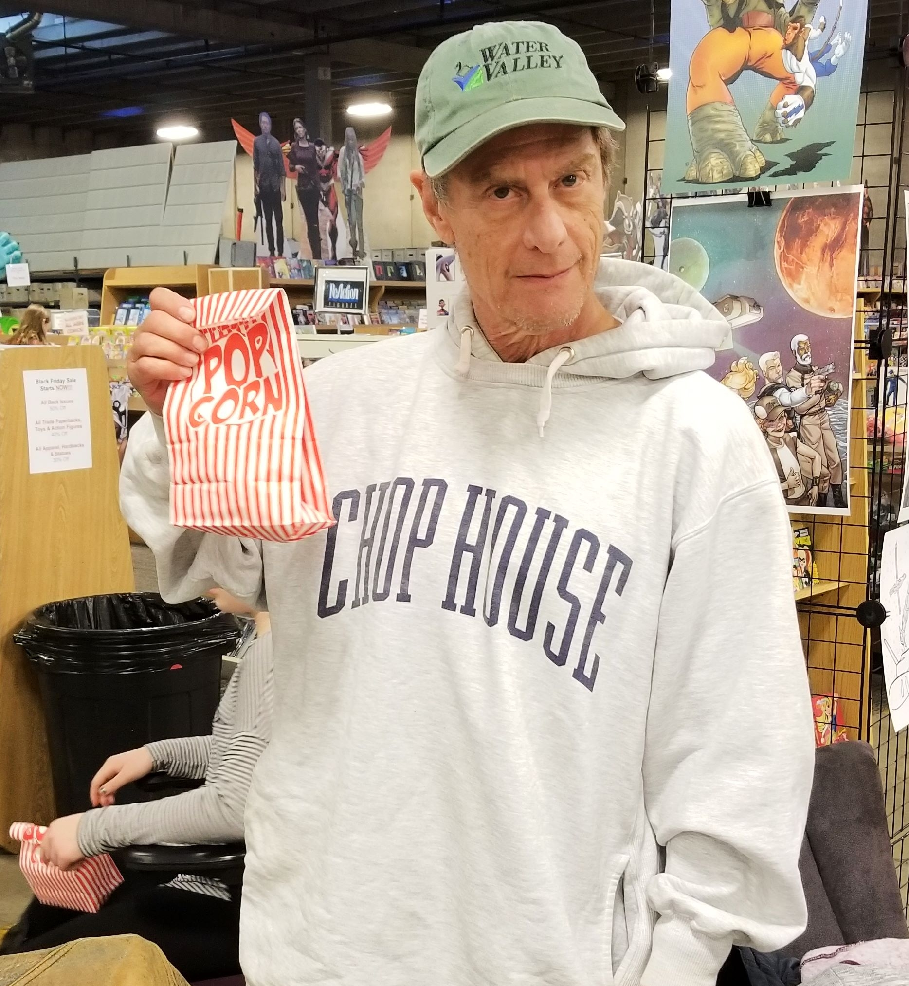 Mike Baron (and his popcorn) at the Centennials launch party.