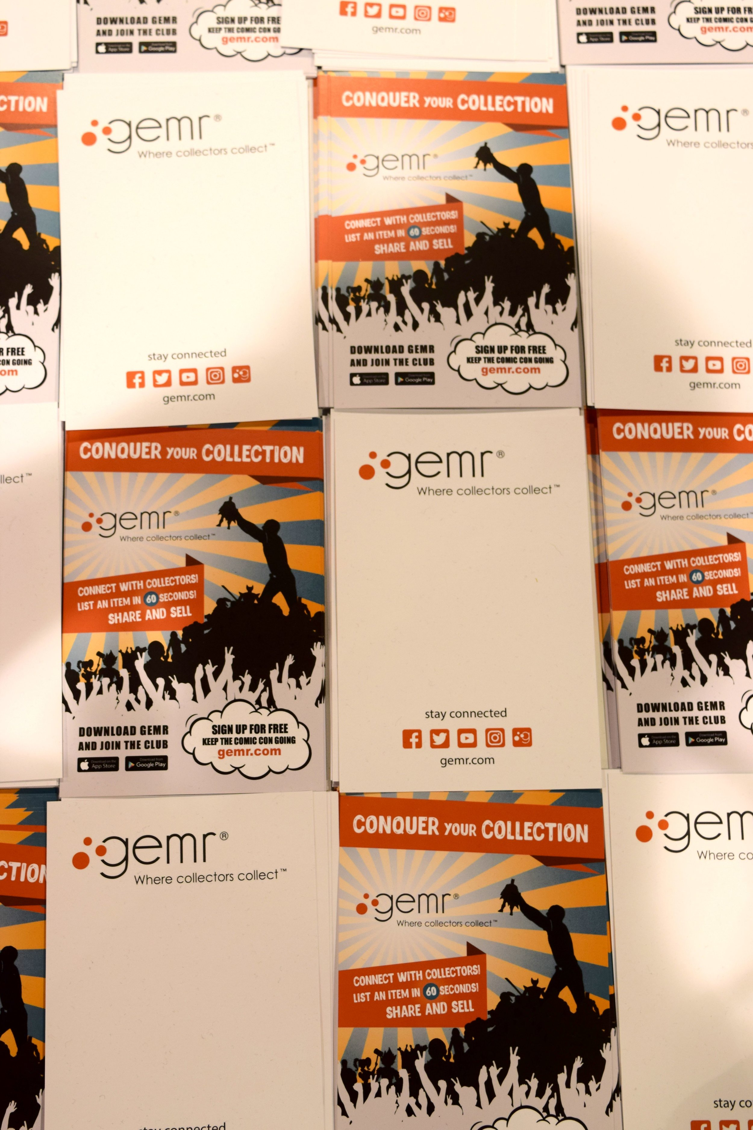 A table full of gemr.com flyers at Phoenix Comic Con 2017.