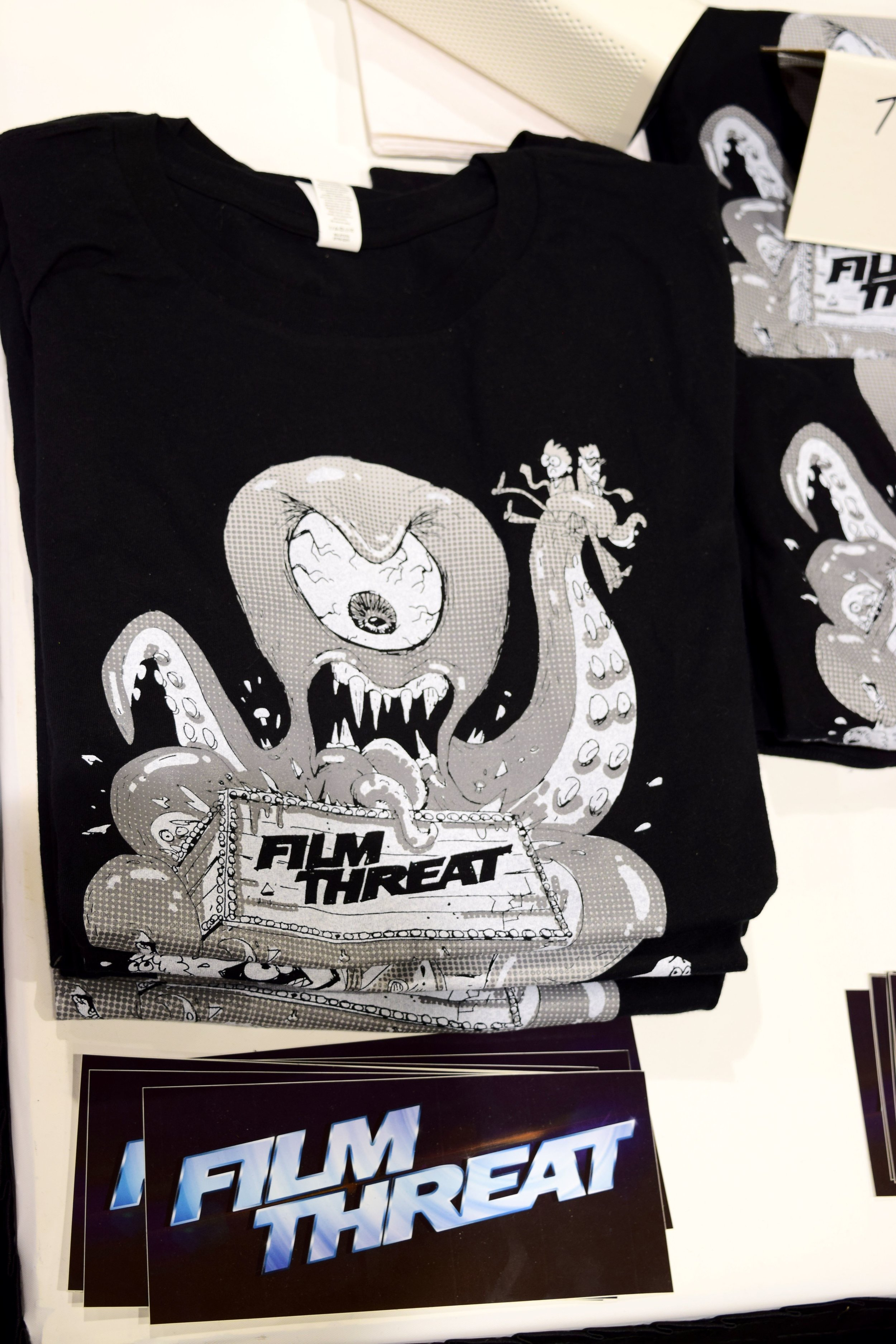 Film Threat t-shirts and stickers at Phoenix Comic Con 2017.