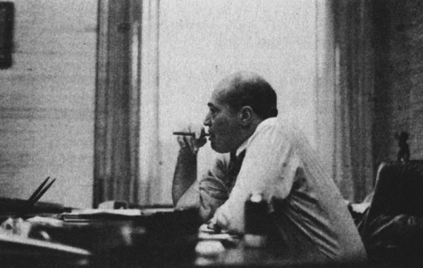 Carmine Infantino sitting at his desk.