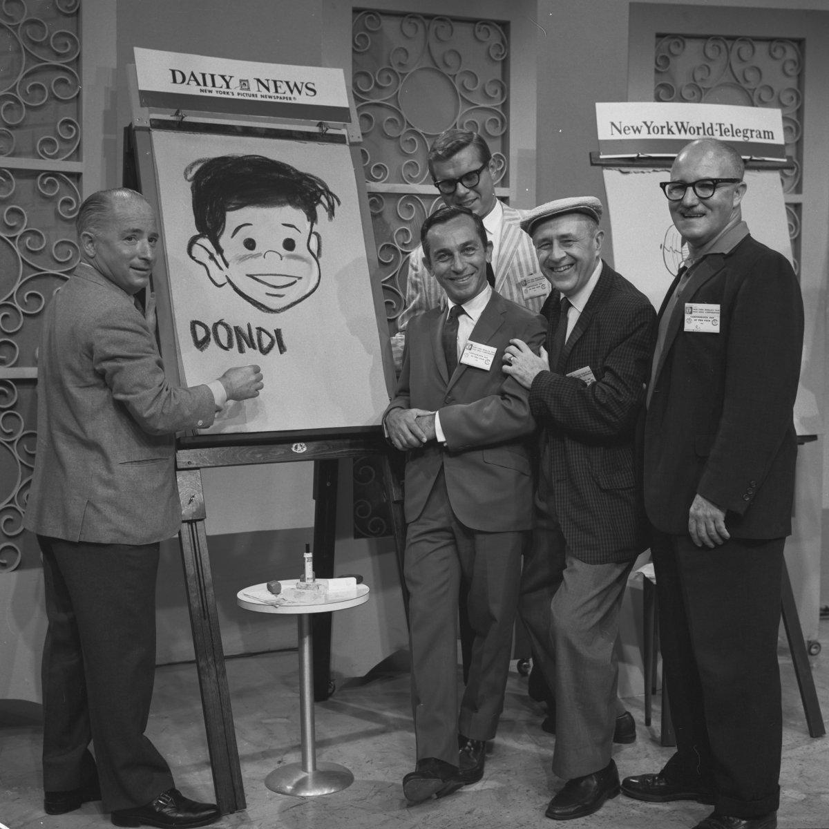Irwin Hasen shows Daily News cartoonists how he did what he did. From the left: Irwin Hasen, Alfred Andriola; Bill Holman, and Don Figlozzi and (rear) Leonard Starr.