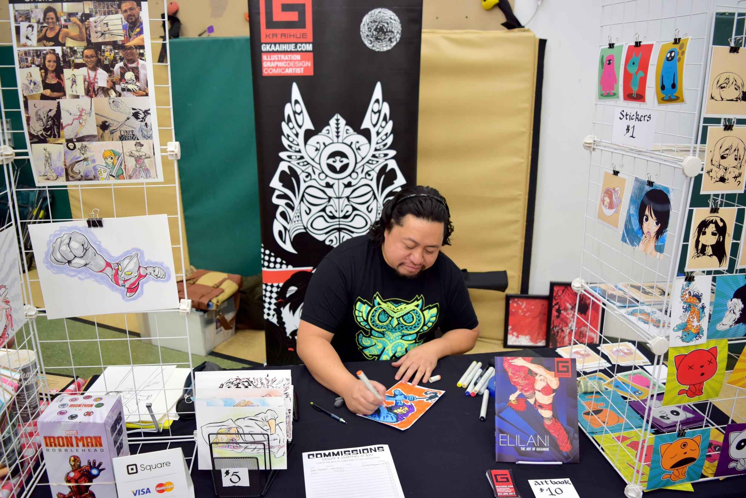Gerhard Kaaihue  sketching at the mini-con.
