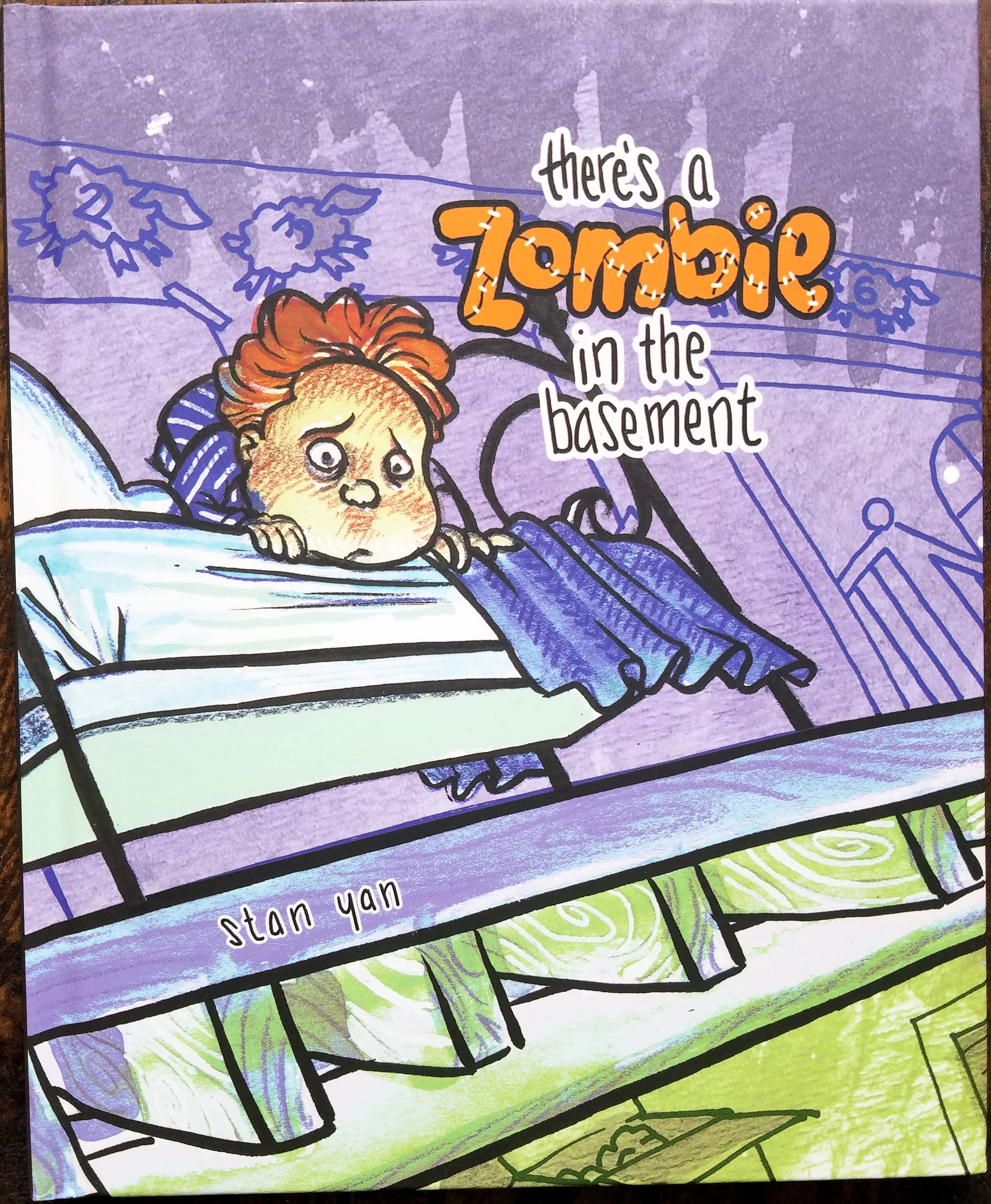 There's A Zombie in the Basement  - a story book by  Stan Yan .