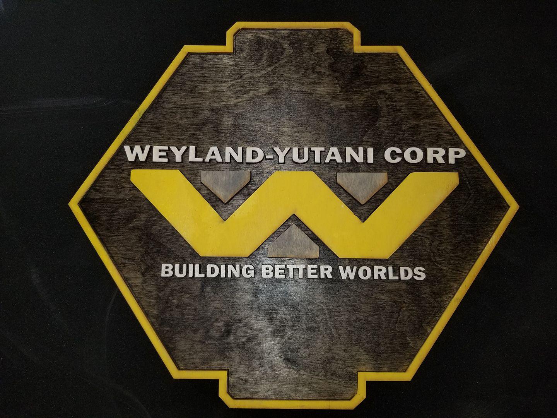 A Weyland-Yutani Corp placard from MacWolf Productions.