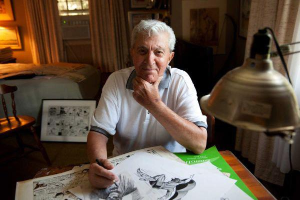 Al Plastino at his drawing table, working on a Batman sketch.