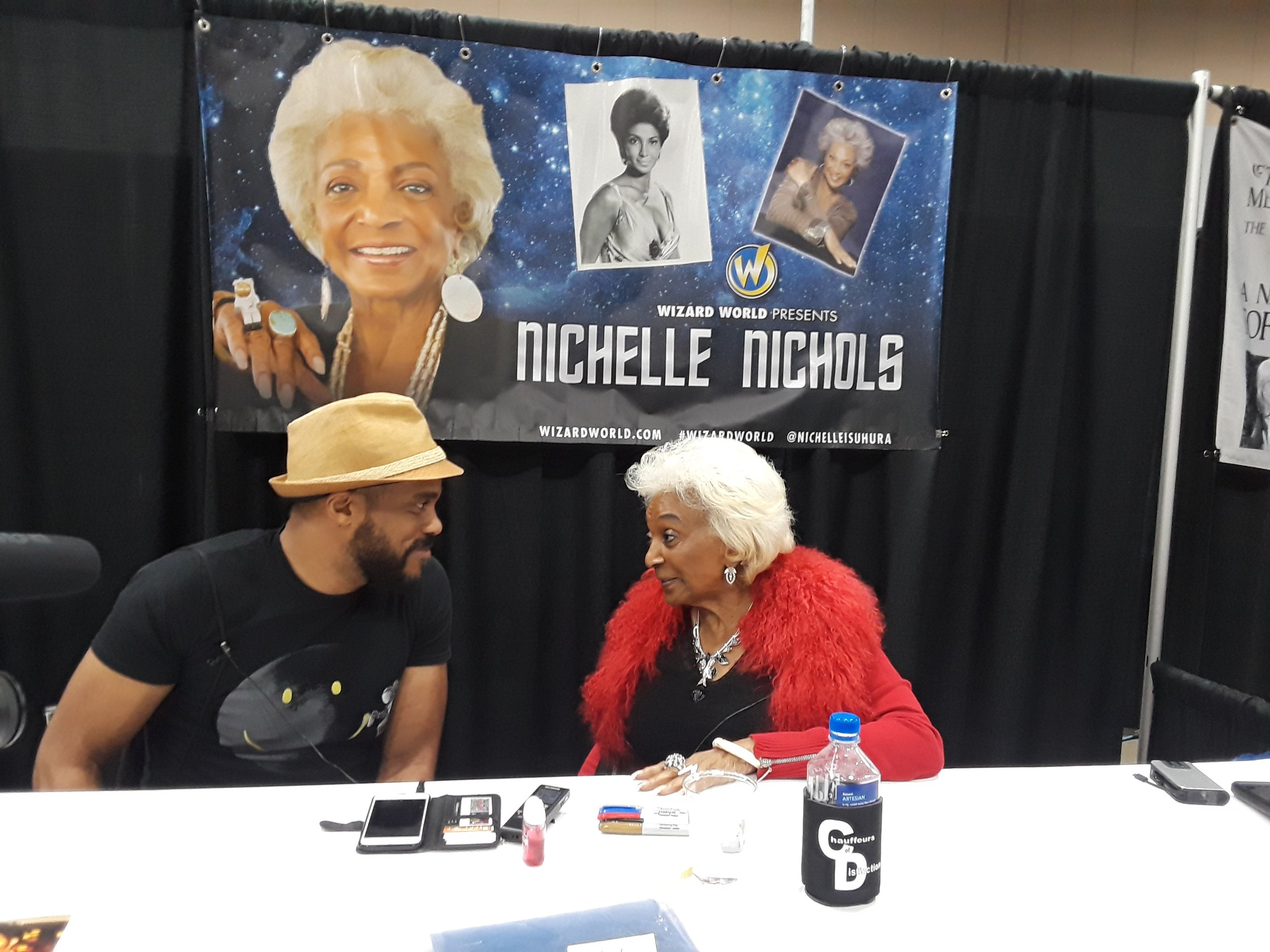 R. Alan Brooks  talking with  Nichelle Nichols  at Wizard World Des Moines 2018.
