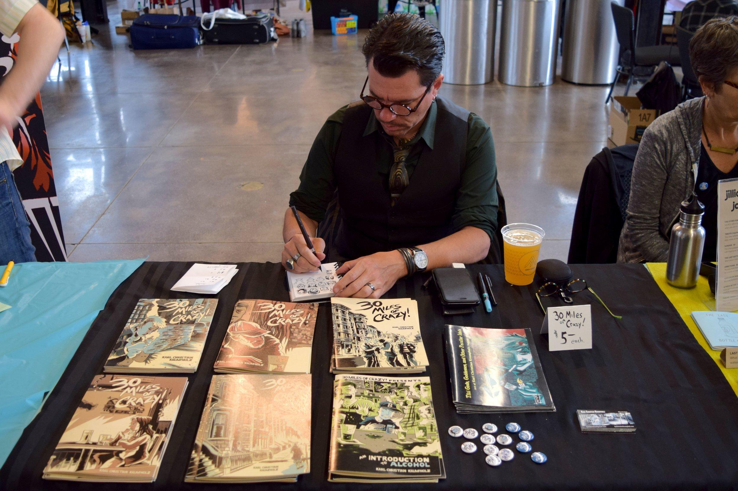 Karl Christian Krumpholz drawing silly faces at  Denver Zine Fest 2018 .