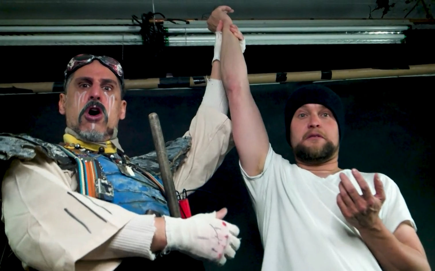 Hagar T. Mangtooth  holds aloft the hand of  Daniel Crosier , writer & director of  Camp Crash !