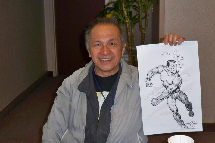 Ernie Chan holds up a Namor commission.