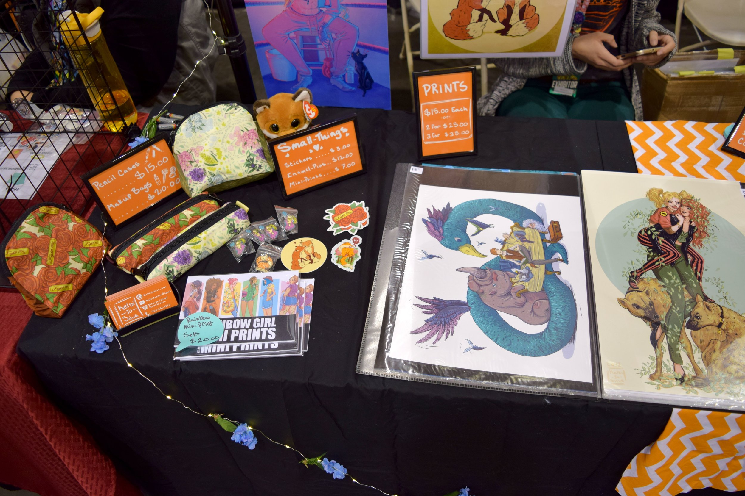 Enamel Pins, Stickers, pencil cases & prints from Kelsi Jo Silva at Phoenix Comic Fest 2018.