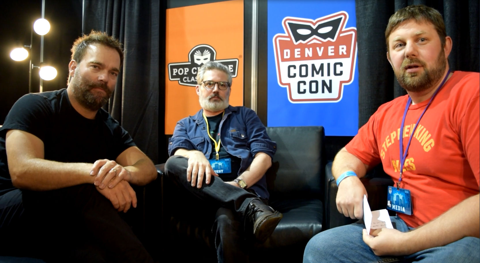 Andre Gower ,  Ryan Lambert , &  Abrahm Akin  sitting at Denver Comic Con 2018.