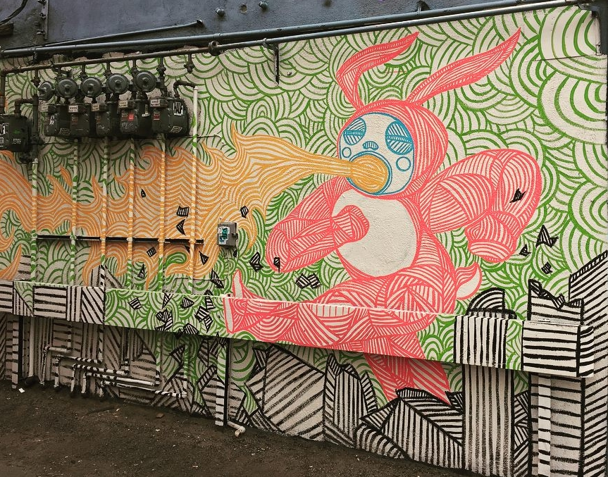 "The original ""kaiju bunny"" mural behind Mutiny Information Cafe, done by Daniel Crosier."