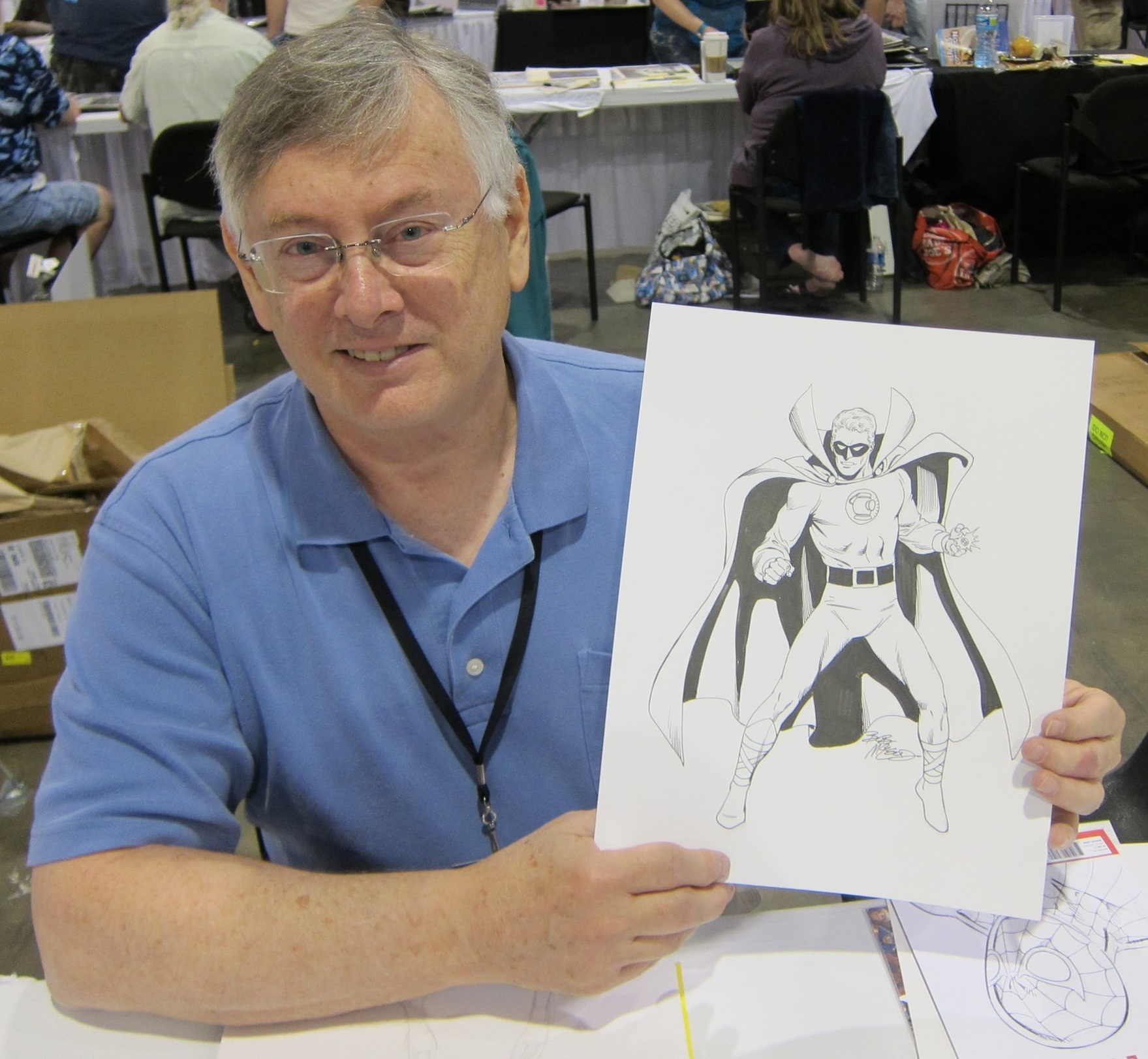 Bob McLeod holding a Green Lantern commission.