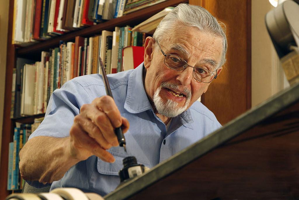 Hy Eisman at his drawing table.