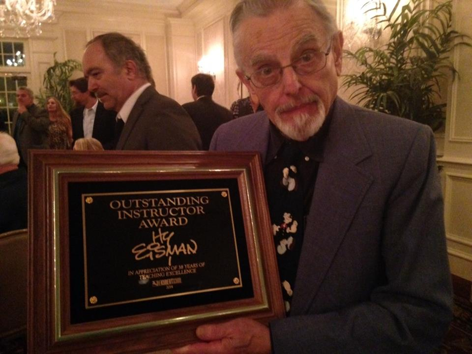 Hy Eisman recieving the Outstanding Instructor Award from the Kubert School - in recognition of his 38 years teaching.